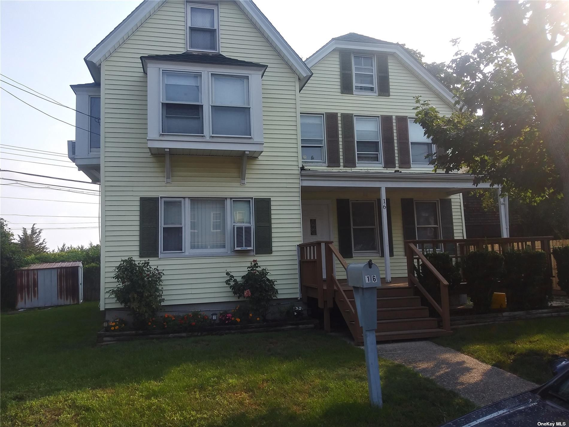 """Vintage Colonial, spacious, bright, water view property. 10 rooms (2 bath rooms) with detached garage. Minutes from Beach, railroad, and downtown Oyster Bay. Sold """"as-is."""" Possible mother/daughter with proper permit."""