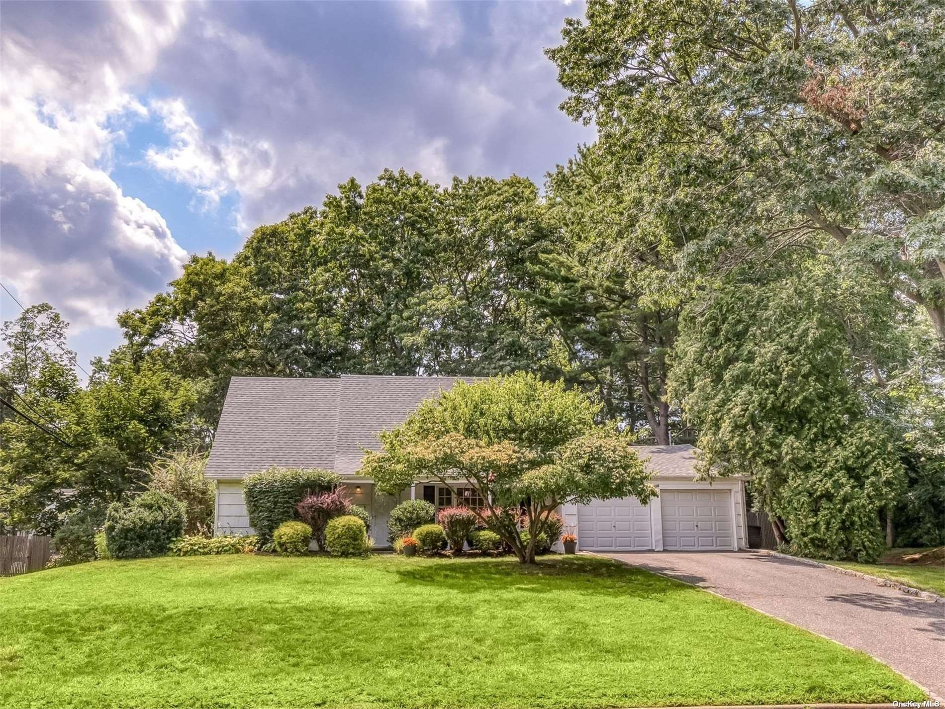 """Are you still searching for a home that offers that something extra special?  Look no further!  In addition to the young roof (2018), thoughtfully renovated """"Actual Chef's"""" kitchen, updated bathrooms, new gas heat and boiler (2018) Serene gardens with lush landscape and an expansive patio perfect for entertaining or dining al fresco.  Every inch of this home and property is a delight to the senses and one that you will love experiencing firsthand!"""