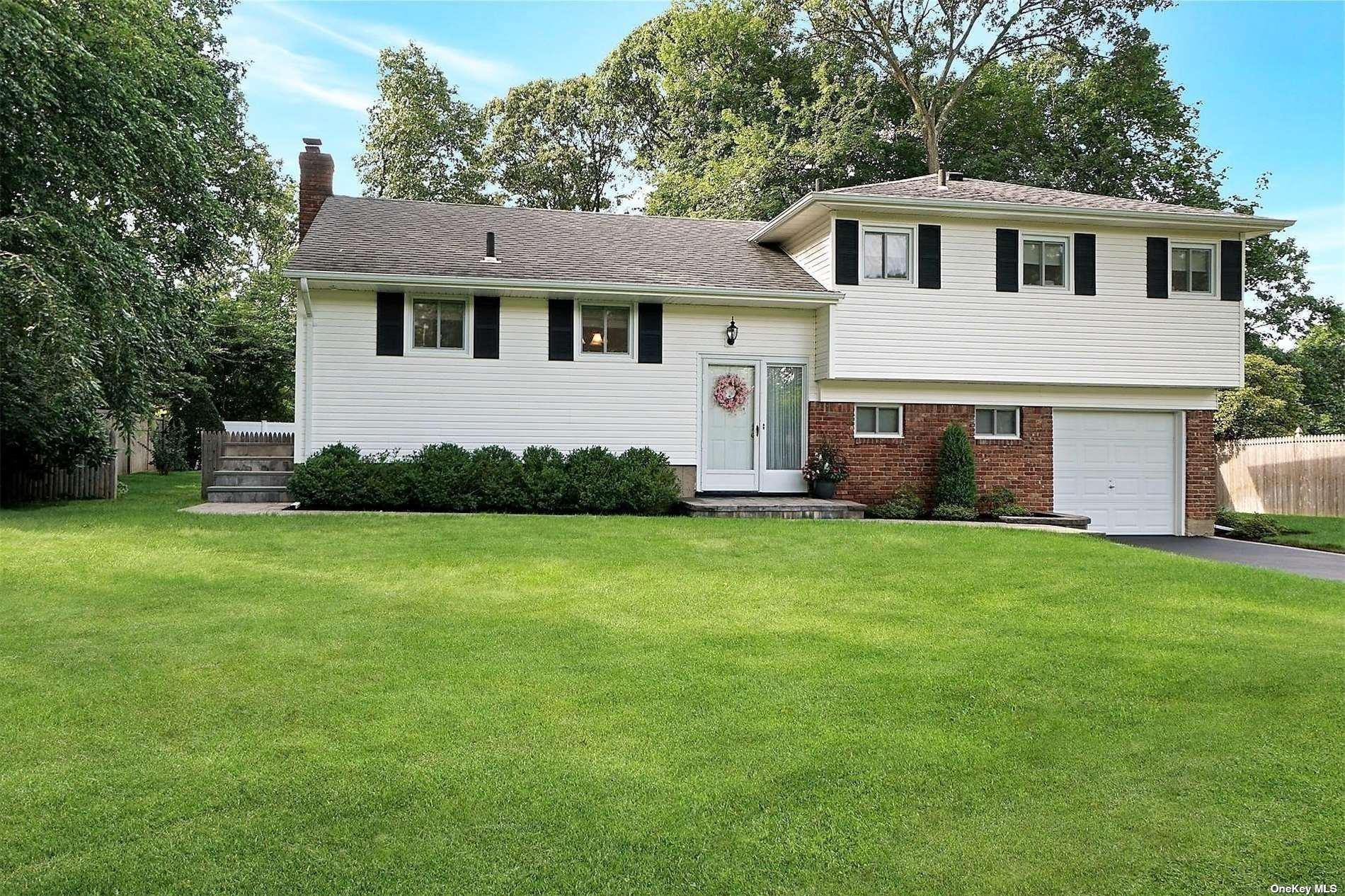 Pride of Ownership! Immaculate Split Level in Sought after Bird Section, Hardwood Flooring, Updated Windows, Siding and Roofing, Newer EIK with Granite/Stainless Appliances, Updated Baths, Newer Driveway and Paver Walks, Beautiful Flat and Usable Fenced Yard, Property Taxes with Basic NYS Star $8,458.84.