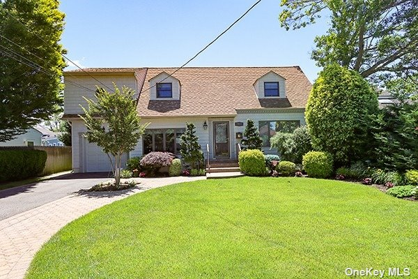 Pristine, Immaculately Maintained, Light and Bright Colonial on Dead End Street Offers: Expansive Wood/Granite EIK w/Viking Range, Frig, Micro, w/Sliders to Large Deck.  Updated Half Bath, Huge Master Bdrm w/2 WIC, Large Mstr Bath w/Dual Vanity, 3 Large Bdrms, Updated Full Bath, Andersen Wdws, Hi Hats, Crown Molding, Paneled Doors, French Drain, Waterproof Crawlspace, Air Purifier, Whole House Generator, Marine Wiring (First Floor), Prof. Landscaped, Private Yard, Pavered Path, 1.5 Garage.  Call Listing Agent for Details Regarding Open Permits.  PRICED TO SELL!