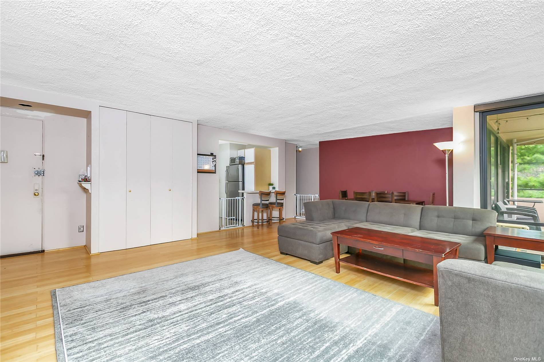 lovely one bedroom with bamboo floors throughout...updated kitchen and bath...Ceiling to floor windows throughout...steps from pool and playground...complex has 2 pools, 3 tennis courts, 2 playgrounds, gym and cafe...prime parking space included in sale.
