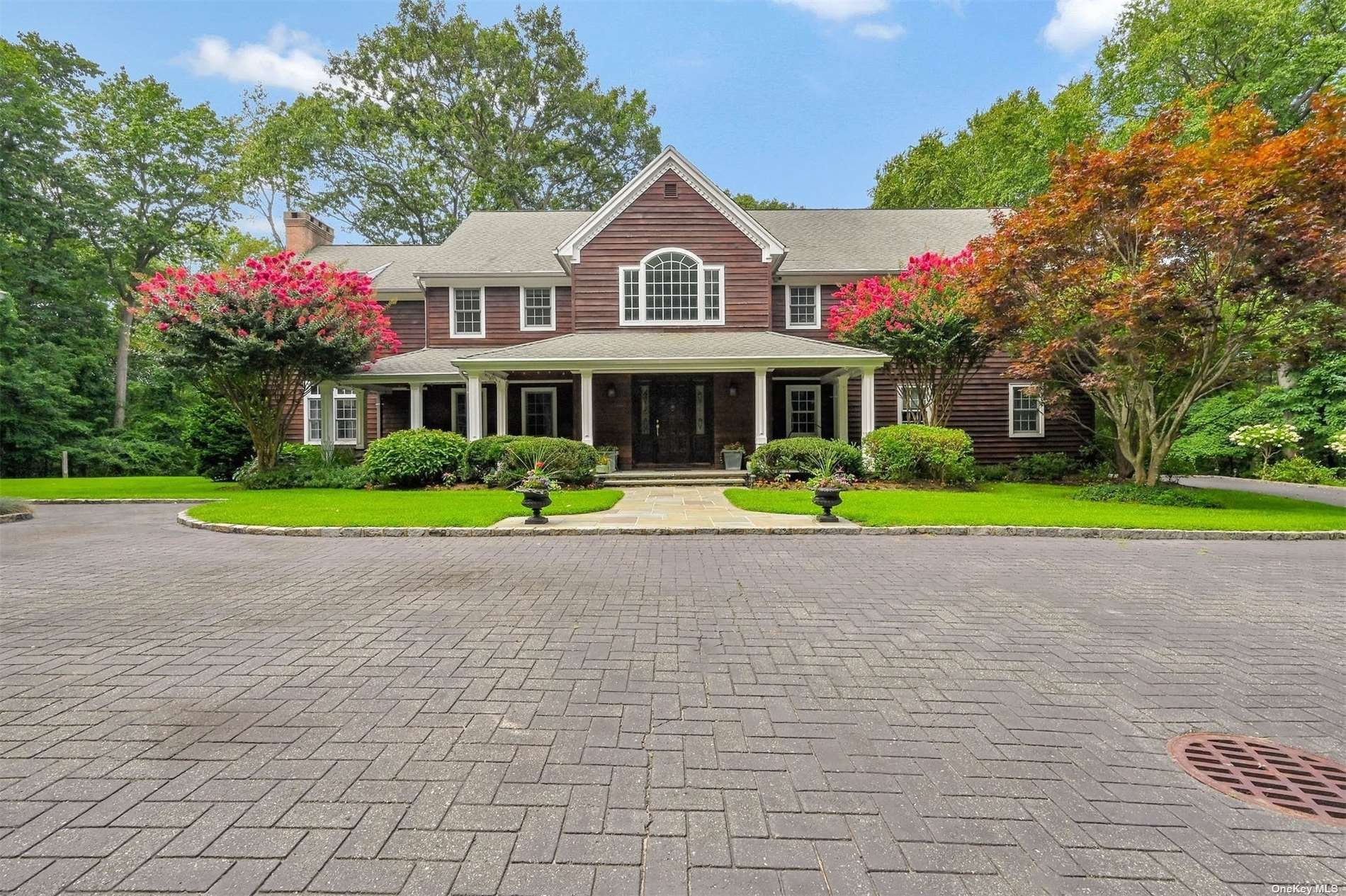 Looking for the perfect home on the North Shore's Gold Coast with peaceful surroundings, yet 10 minutes to thriving Huntington Village?  Welcome to 29 Fiddlers Green.  This 2 acre estate borders Caumsett State Park's Hiking Trails and is down the block from the Fiddlers Green Private Association Beach with dock and mooring rights on the Long Island Sound.  This Cedar shake Hamptons-Style home was built in 2000 and boasts a front covered porch and features all of the amenities needed for today's lifestyle. Sunlit rooms with walls of windows, high soaring ceilings and custom millwork are just some of the amazing features of this residence.  The open floor plan, chefs kitchen open to den and large principal rooms make this a fabulous home for entertaining.  The finished walk out lower level with wine cellar and the 3 car detached garage are added bonuses to this home.  Cold Spring Harbor SD