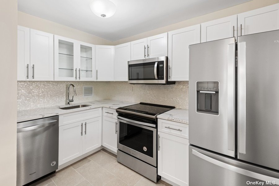 Sponsor Apartment - No Board Approval. 2BR / 1BTH With Terrace - Incredible Value. Modern, Custom and Designer Renovation Just Completed Throughout The Entire Home. Vacant And Waiting For Your Personal Touches. Washer Or Dryer On Every Floor. No Dogs Allowed. Le Havre Amenities: A Fitness Center, 2 Outdoor Pools, 3 Tennis Courts, Clubhouse, Fitness Center, And Restaurant.