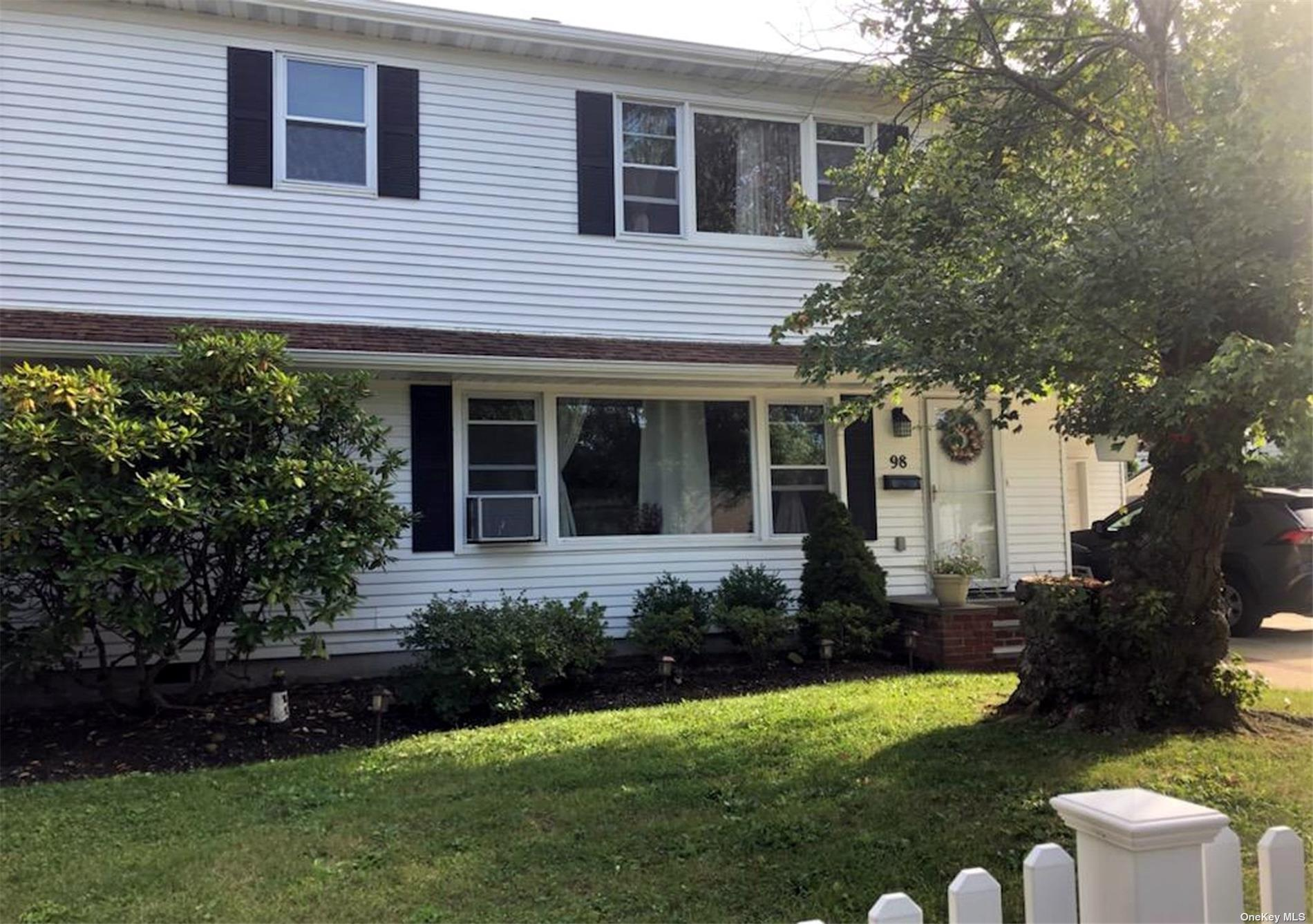 Nestled in the charming community of South Amityville, you'll discover this beautifully renovated 5 Bedroom, 3 bath waterfront Colonial with a newer bulkhead , just a stone's throw from the open bay!  Renovated in 2015, features include a roomy, remodeled EIK with granite, contemp cabinets and Stainless applis, a luxurious 2nd floor Prime BR suite with vaulted ceiling, WIC and full bath including soaker tub, separate shower, dual sinks, and sliders to a personal 2nd story deck offering waterviews.  This amply sized home includes 4 addl bedrms, a sleeping loft, 2 addl renov baths, a 1st floor Lndry rm, a 2nd floor Family rm and a flexible layout for accommodating extend family. Includes pvt garage and drive, space to keep your boat and access to Private Amity Beach! Poss m/d proper permits required.