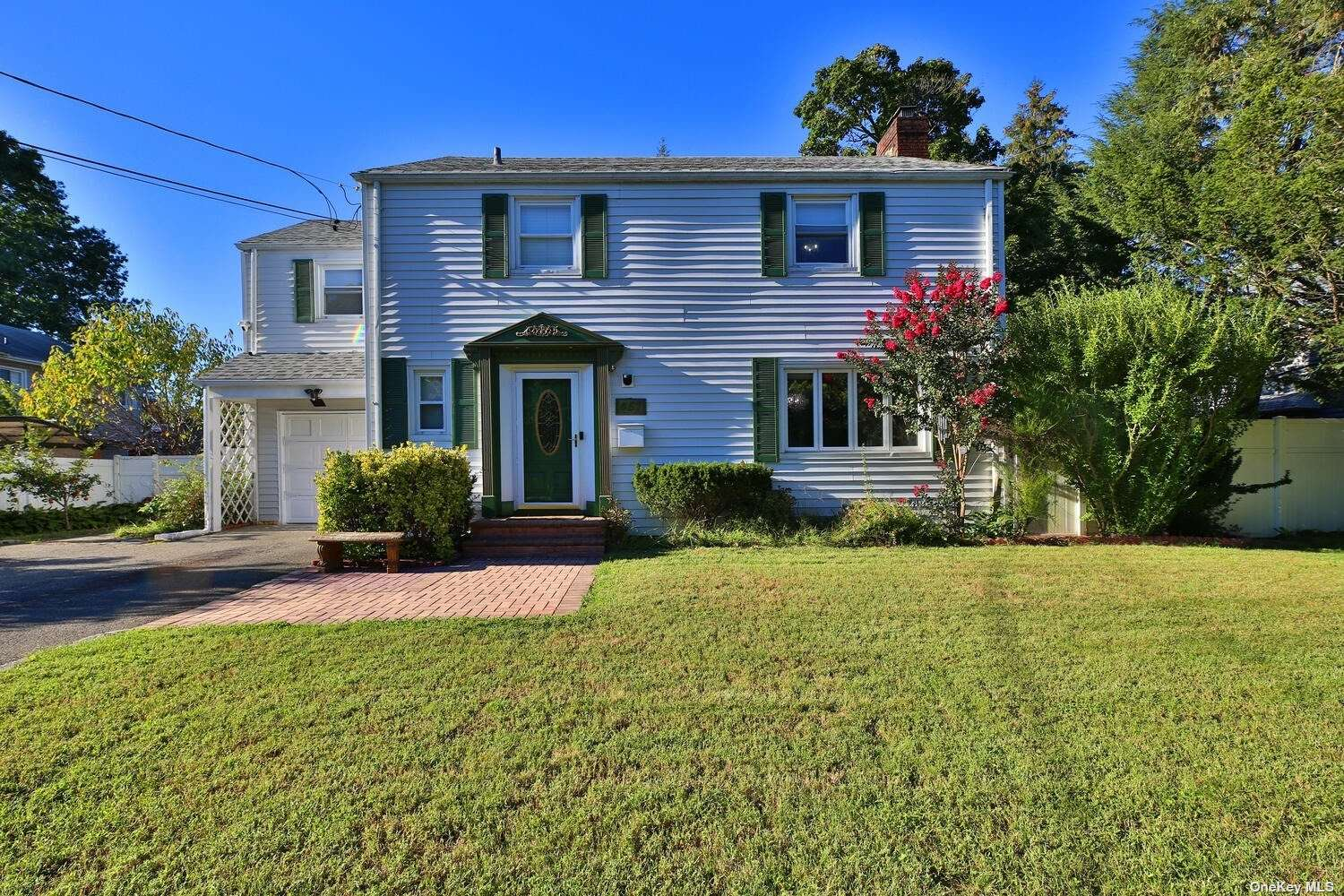 Beautiful 4 Bedroom Colonial in the desirable Estates Section of Westbury, Conveniently located to all shops, restaurants, LIRR, highways, etc. Living Rm w/Fireplace, Formal Dining Rm, EIK w/granite countertops, Den, Fenced 80x100 property, 4 Bedrooms, 1.5 baths, 1 car Garage, Full Basement