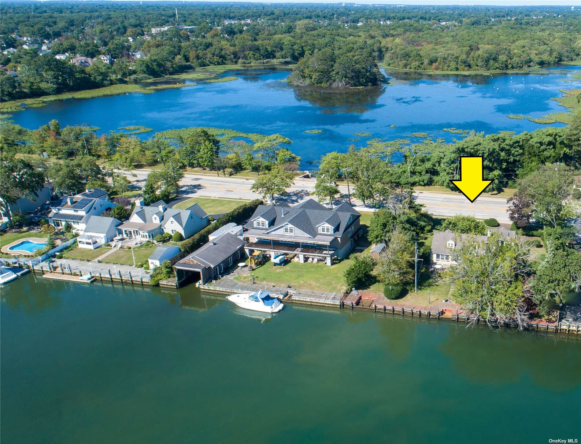 BOATER'S PARADISE With 139' Of Bulkhead on Grand Canal Just Seconds To The Bay!! Great Opportunity To Make This Waterfront Home Your Own.  Situated On .53 Acres In Desirable Biltmore Shores, This Charming Cape Boasts 3 Bedrooms, 3 Full Baths, Hardwood Floors, Formal Living room With Stone Fireplace, Formal Dining Room, Sunroom/Breakfast Room, Sitting Room, Separate Guest Quarters With Balcony, Master Bedroom With French Doors To Roof Deck Overlooking Rolling Lawn To Your Own Private Bulkhead, Central Air Conditioning, Generously Sized Rooms With Walls Of Glass and Panoramic Views of Canal. Low Taxes Only $16,489.......Don't Miss This One!!