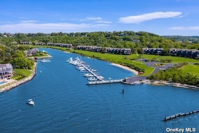 Welcome to Gated Harbour Point Complex on Northport Bay.  Living in this Special Waterfront Community is a Lifestyle Makeover.....No Worries over Yard Maintenance or Snow removal, and you have Your Boat in your own Backyard !!! Not to Mention the new Community Pool, Clubhouse & Tennis Courts. This Browning Unit has 3 Living Levels, a Bedroom & full Bathroom on the 1st floor should you need it for Mom, and a Center Island European Kitchen for your Gourmet Dinners. The Fireplace & Heat ( Brand new Burnham) is Natural Gas . The newly installed Bamboo floors on the 1st Level as well as in the Primary bedroom upstairs bring a warm feeling to this home. Gaze at the Water & Drift away....come Home to that Vacation Feeling 365 days a Year!!!