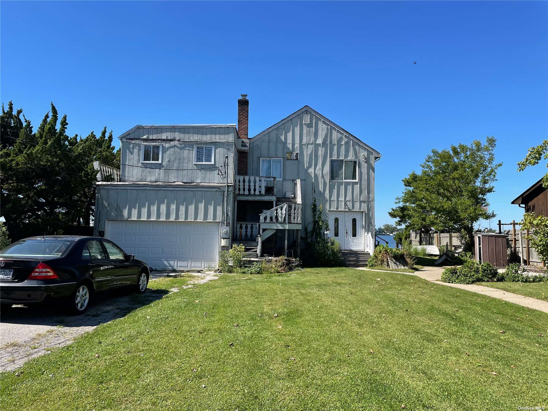65 X 158 Property on Open Bay with Pristine View a Builders Dream Come True