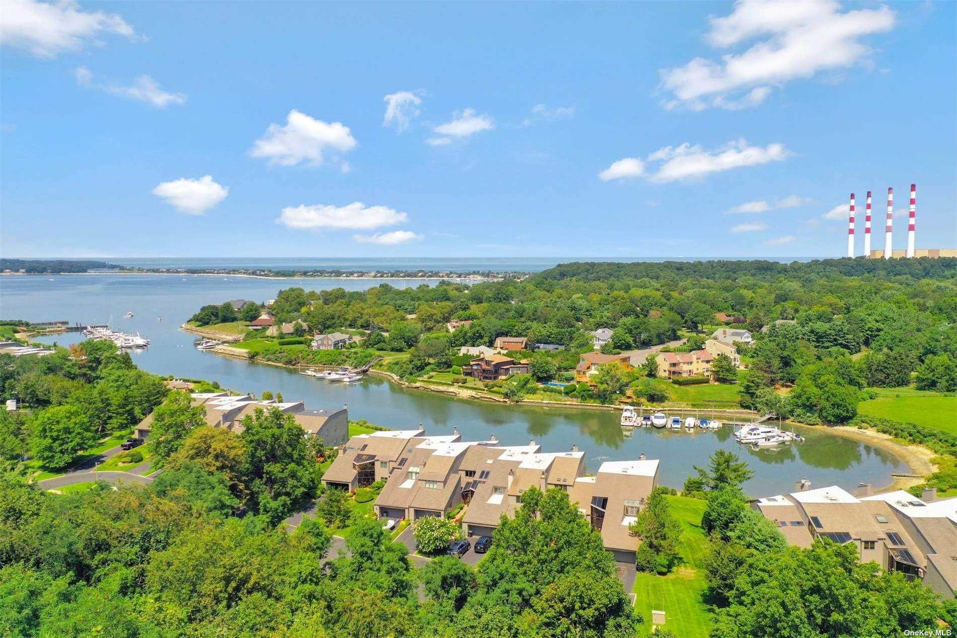 Spectacular, Completely Renovated, Townhouse in Desirable Waterfront Community. This home provides top of the line finishes in every room with attention to detail. Custom moldings, Beautiful hardwood floors throughout, The open floor plan allows for incredible views of Northport Bay from every floor. Enjoy your morning coffee on the the private balcony off the master bedroom. This Community offers the feel of living like you are on vacation every day with its Gunite Pool, Tennis Courts, Private Marina W/ deeded boat slip and meticulously manicured grounds. Walk to restaurants, shops, and parks in historical Northport Village. This Home has ir all and is a MUST SEE!