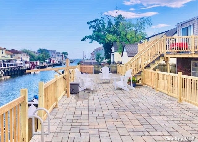 """Breathe the Salt Air & Park your Boat &  JetSkis on wide """"Albert Canal"""" leading right to open Bay! Brand New 60' Bulkhead! Magnificent 60'x15' Raised Paver Patio over a 60x15 Retaining Wall! Brand New Concrete Patio & Walkways. Foundation SkimCoat w/Acrylic Waterproofing! Drainage System w/Maintenance-Free River Rock/Authentic Nautical Landscaping w/Roping. New Vinyl Siding/New Bi-Level Decking/Newer Roof/Chimney Cap/Updated Windows/Kitchen. New Designer Tile Baths. Natural Gas to House w/Gas Cooking. Weil McLain Burner 9 yrs. 1st Flr-Patio Level & Water-Resist. Materials. Sold As-Is. Great Investment. One of the Best Streets in Freeport. 3 Flrs by CO! 2 Living Rms. Great Layout for Extended Fam. Enjoy Renowned Restaurants/Shoppes/Fishing & Party Boats, Freeport Christmas Lights Boat Parade! Parks & Freeport Recreation Ctr. Close to Meadowbrook Pkwy/Sunrise Hwy/Jones Beach & JB Theater/Business Districts/Courts/Roosevelt Field/LIRR Express Train. *Voted 7th Coolest Town in USA!"""