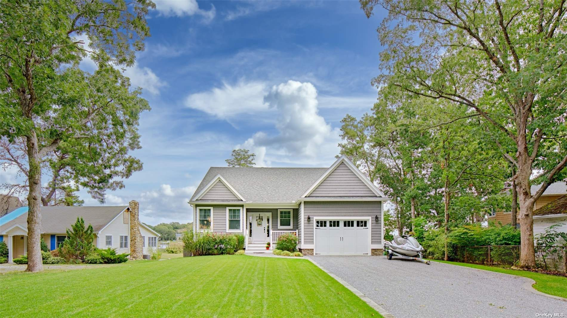An Exceptional Aquebogue 2019' Beachfront Masterpiece in the Heart of Long Islands Wine Country. 96' of Sandy Waterfront, Private Mooring and Stunning Views of the Peconic Bay, This Well-Appointed, Architects Custom Ranch Was Mindfully Designed and Built to Facilitate a Premier East End Lifestyle. Exterior Curb and Grounds are Highlighted by a Curated use of Stacked Stone and Cedar Impression Siding. Enter Into an Open and Flowing Concept with Doublewide Reception and Hall. Gleaming Hardwoods Guide You Into a Gourmet Chef's Kitchen and Entertainer's Living Space Wrapped in Anderson 400 series Windows and Doors, Gas Fireplace and Uninterrupted Views of the Peconic Bay. Master Suite with Walk-In Closet and Adjoining jack and Jill Nursery Suite or Office. Two Guest Bedrooms off Main Hall Serviced by Oversized Guest Bathroom. Egress to private outdoor shower and 32'x12 Timbertech Deck overlooking Beach and Bay. *Additional 980 Sqft for Potential Second Story Addition! A Must See!