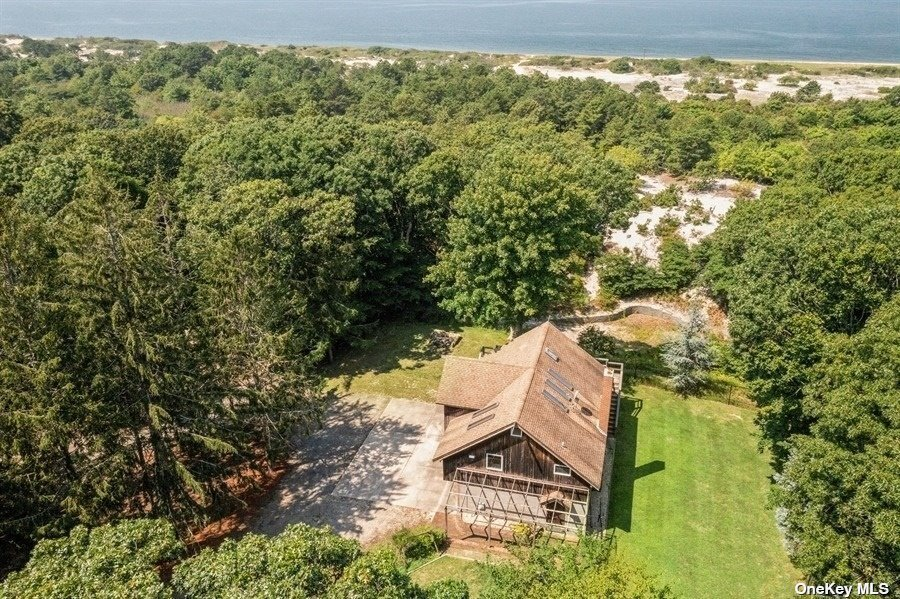 Spectacular Waterfront Oasis Located In Peconic Dunes. Features 9+ Acres Of Luch Woodland. Overlooking LI Sound, With 250 Feet Of Sandy Beach For Swimming And Fishing. Incredible Sunset, Nature Trail Amongst Blueberry, Cranberry & Beach Plums. Osprey Platform In Dunes, Achery Hunting, And Much More. Existing Structure On Property Is Sold As Is And The Perfect Spot To Build Your Dream Home.