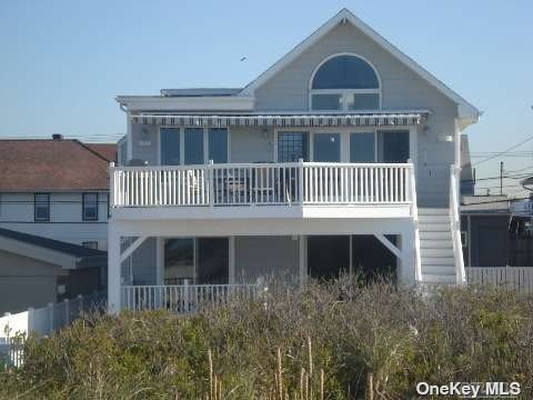 Beachfront home with beautiful ocean views, 5  bedrooms, 2 Fantastic Decks, 3 Fireplaces, Lots of Parking. Has it all come see!!!