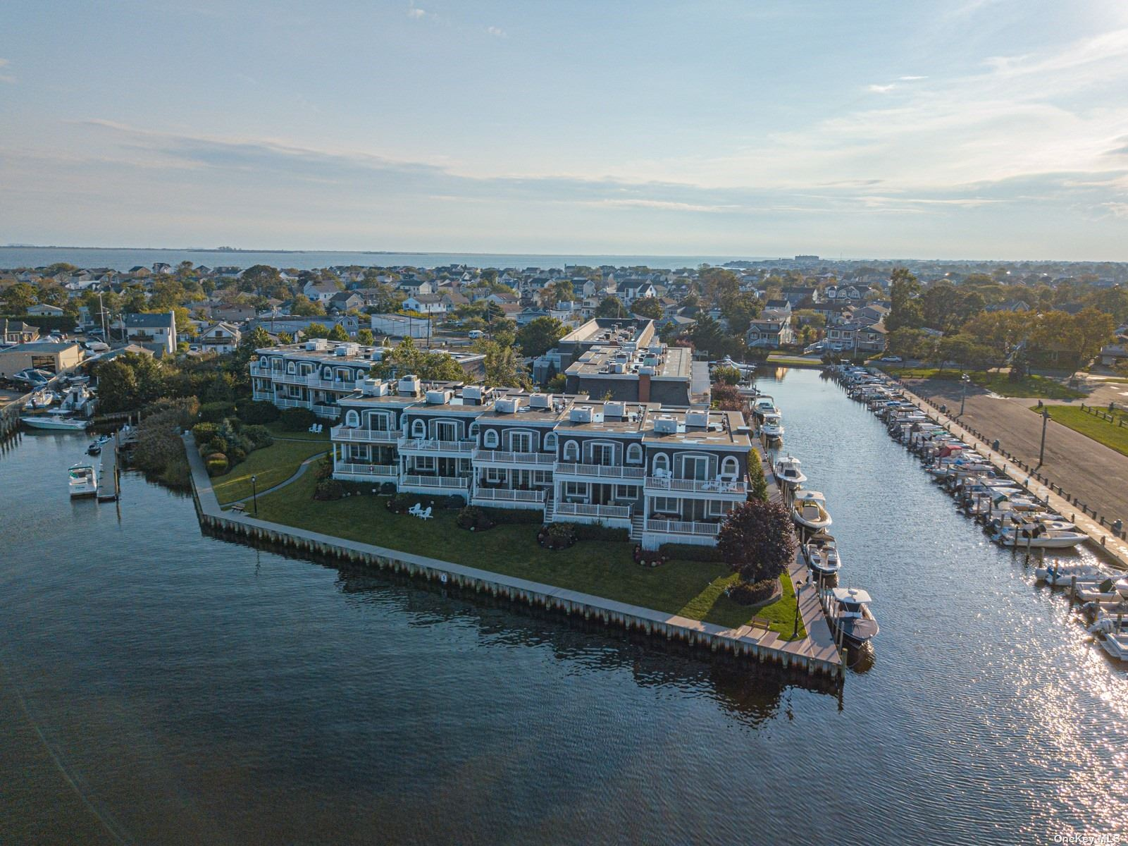 Gorgeous Waterfront Townhome With Sparkling Views of The Great South Bay, 3 Bedroom, 3.5 Bath Home, Beautiful Eat-In-Kitchen Leading Into A Bright And Open Den With A Fireplace And Plenty of Space To Entertain. Off The Den Are French Doors Leading Out To A Deck Where You Can Soak Up The Views of the Bay. Similar French Doors Lead Out of The Master Bedroom Onto A Private Deck Where You Can Enjoy Your Morning Coffee With The Sunrise.