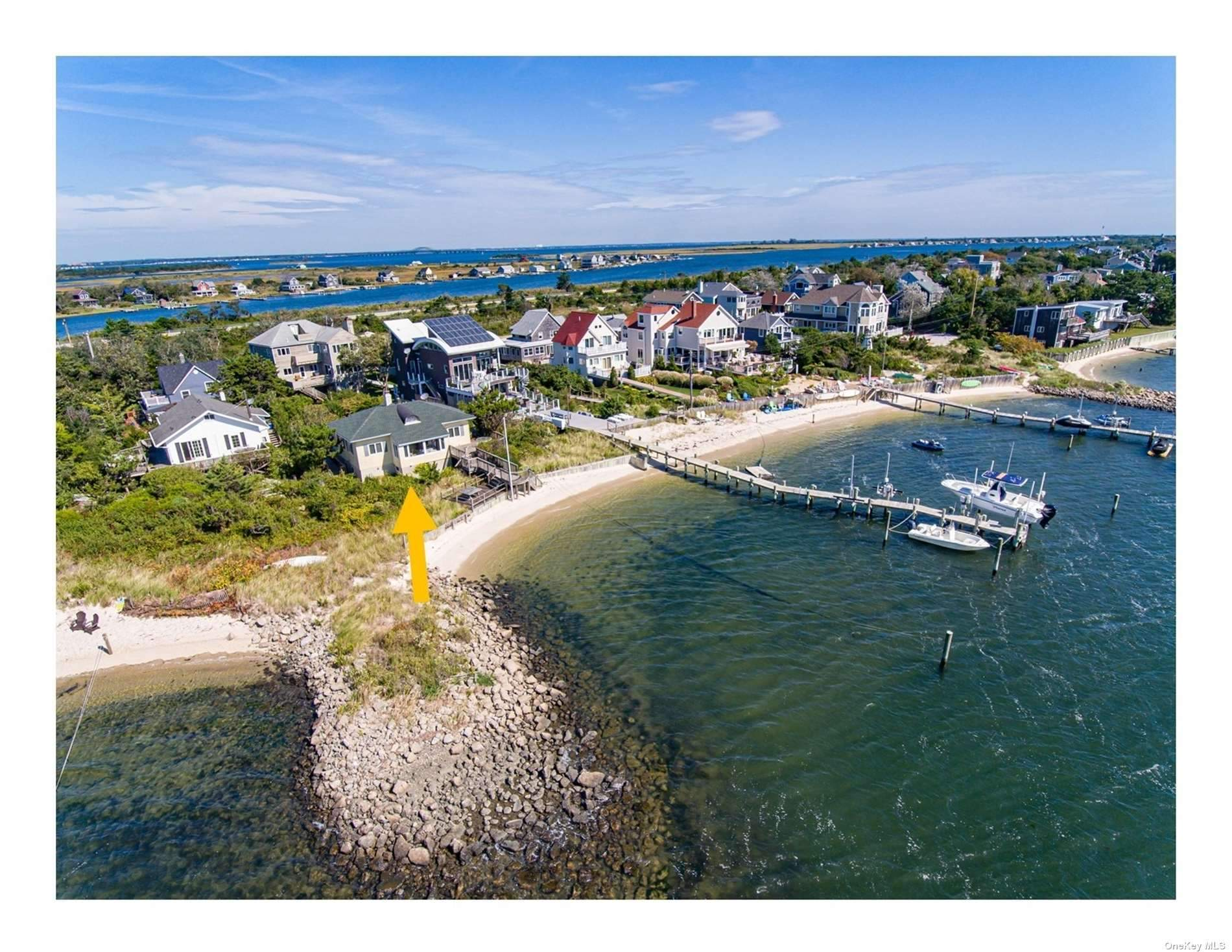 Bayfront Beach House on Western End of Oak Beach. Vintage charm abounds and vacation views await you.  LOW annual flood insurance $ 4,568. Sandy beach and the ultimate in privacy are just a few of the benefits of the Beach Life.