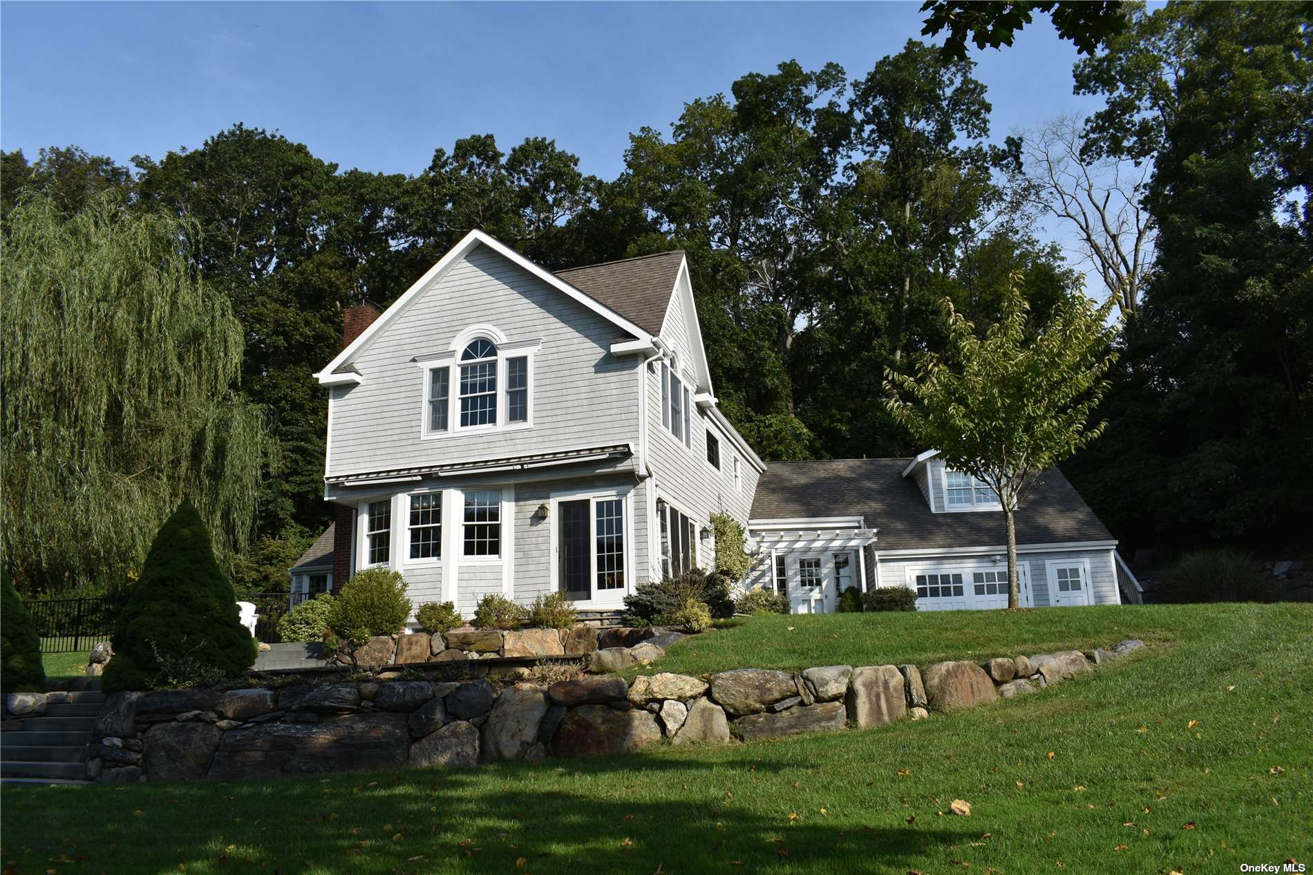 Sunsoaked and meticulously renovated turn-of-the-century jewel box overlooking the Stony Brook Harbor and Nissequogue Golf Club! Enter through your gates, down a 400 foot stone driveway to this hidden gem! LOWEST taxes for Nissequogue! Privacy galore! No expense spared in the complete renovation both inside and out - new heated gunite pool, new barn, bluestone patios and stone walls, new Brazilian cherry wood floors and staircases, new kitchen and baths, handcrafted woodwork, new open loft office/4th bed and bath with separate staircase and outside entrance, and water views from almost every room! Private Stillwaters community beach and mooring rights at foot of your driveway! Hamptons-like living just 50 miles east of Manhattan! Beach, boating, hiking, golf and tennis at your doorstep! Smithtown schools. Annual Stillwaters Community Dues $300. Broker owner.