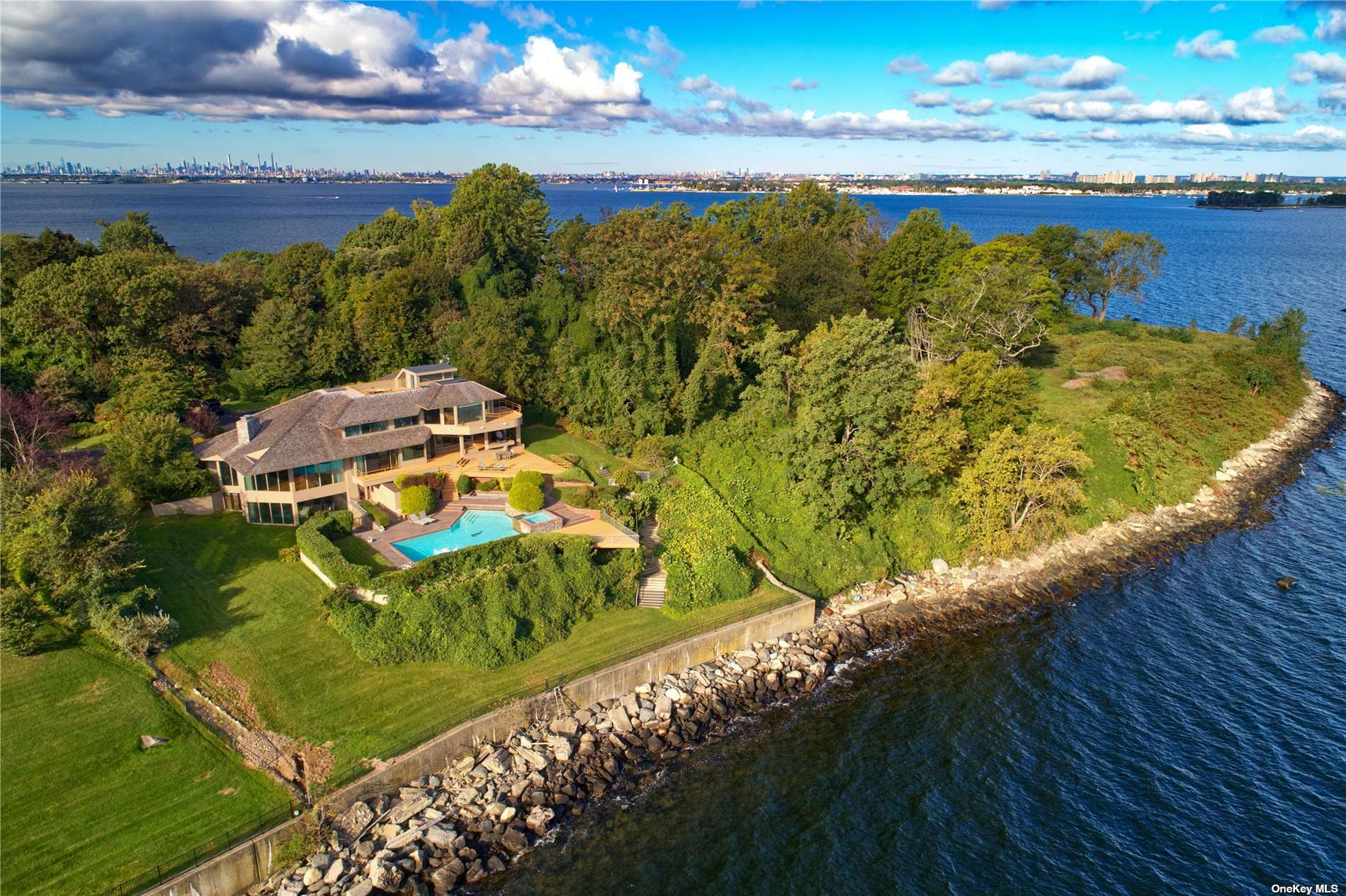 This Architectural Contemporary Masterpiece in the Prestigious Enclave of Kings Point is Set on Over 1 Acre of Waterfront Property on One of the Most Famous and Sought After Address on the Gold Coast of Long Island, Gatsby Lane. Built for Entertainment, the Home Features Exquisite and Expansive Waterfront Views With Floor to Ceiling Windows, Multiple Balconies, In Ground Heated Pool, Game Room, Gym and Many Gathering Areas Throughout the Home and Property. The Primary Bedroom Has Separate Sleeping and Dressing/Sitting Area With Two Full Baths As Well As a Private Balcony and Access to a Private Roof Top Deck Under the Stars. Relax or Entertain Poolside While Capturing the Spectacular and Expansive Breathtaking Water Views of the Long Island Sound.