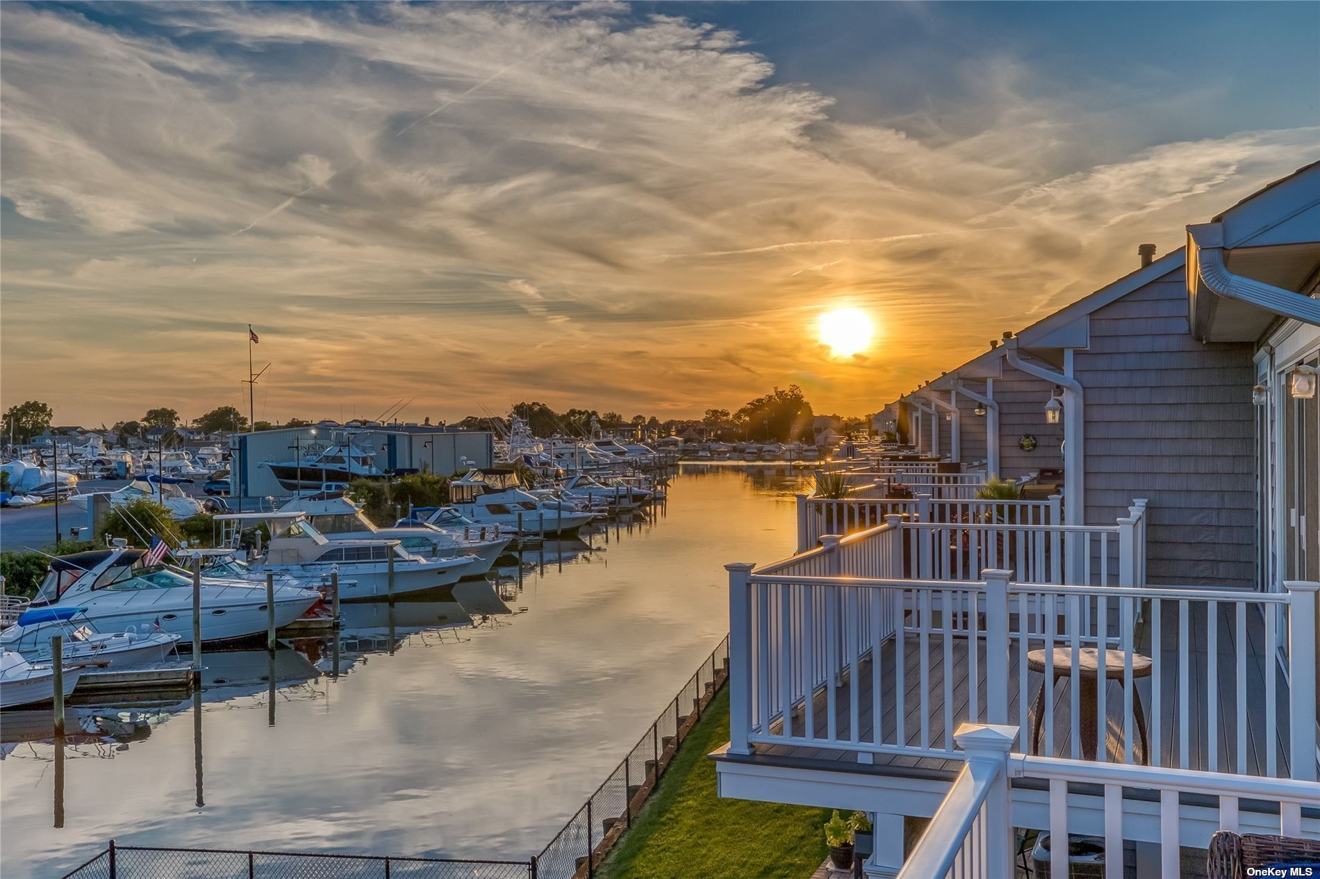 Built In 2017, This 3 Bedroom, 3 Bathroom Open Concept Corner Unit Waterfront Townhouse Was Built To Perfection!! Gleaming In Natural Light With Gorgeous Sunsets, This Townhouse Has Beautiful Finishes Including Hardwood & Bluestone Floors, Granite Kitchen With Gas Stovetop, Stainless Steel Appliances, Designer Bathrooms, Private Waterfront Trex Deck & Brick Patio, Gas Fireplace & Custom Millwork Throughout!! Private En-Suite Bedroom With Custom Closets & Large Full Bathroom Including Dual Sink Granite Vanity, Soaker Tub & Shower With Glass Doors! Additional Features Include Laundry Room, 1 Car Garage & Private Deep Water Boat Slip On Wide Canal, Minutes To The Jones Inlet, Fire Island, Fishing, Shopping & Dining!!!