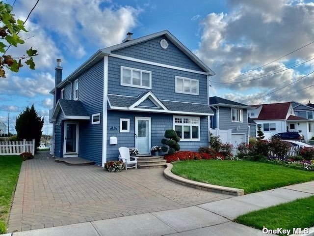 """A Must See!Relax And Enjoy This Meticulous Waterfront Home With Spectacular Views!All Around Mint Conditioned Bay Front Home w/Open Floor Plan Immediate Bay Views Upon Entry,2 Decks South Facing For Perfect Sunsets Air Shows/Firework Shows/Amazing Skies,Low Taxes,3 Car Driveway,Navien Combo Boiler,Gas Fireplace,200 Amp Service W/Generator Plug Hook-Up,2 Zone Heat/2 Zone Cac,Custom Firepit,Outdr Shower,Plenty Of Storage,40'Bulkhd,Floating Dock,Spectacular Views,Walk To Beach,""""Vacation Every Day"""""""