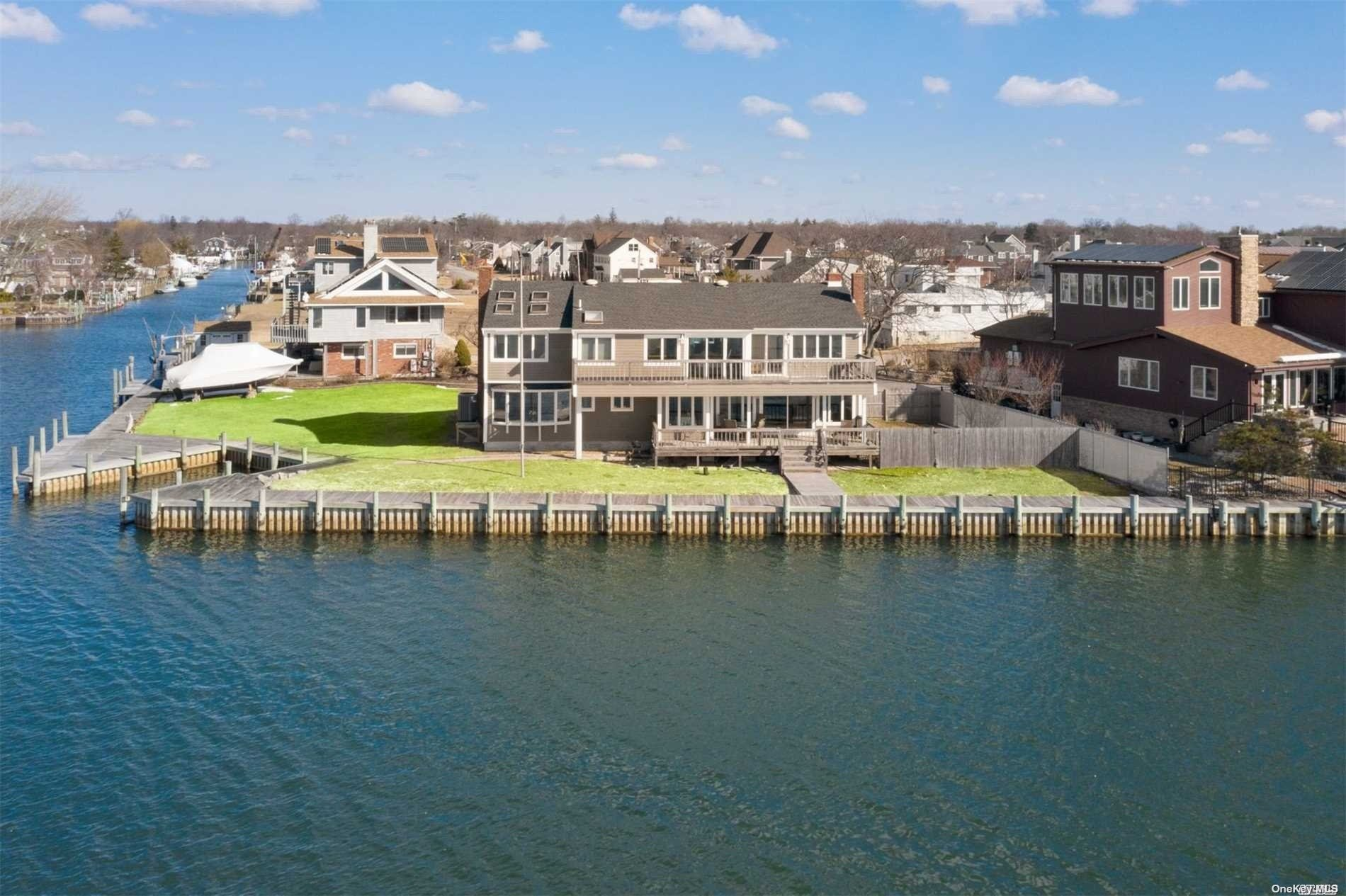 Open Bay Stunner With Absolutely Spectacular Panoramic Views Of Jones Beach, Lighthouse And Robert Moses. This Massive Colonial With A One Of A Kind Bayfront Location Is Waterfront Living At Its Best Featuring 165' Of Bulkhead , With A Boat Slip.  Open Layout First Floor Featuring A Den W/Fireplace And Amazing Views. Expansive Second Floor Featuring A Master Bedroom En Suite W/Full Bath, Balcony And Spectacular Views Of The Bay, 4 Additional Bedrooms And 2 Full Baths. This Location And Home Must Be Seen To Be Truly Appreciated!!