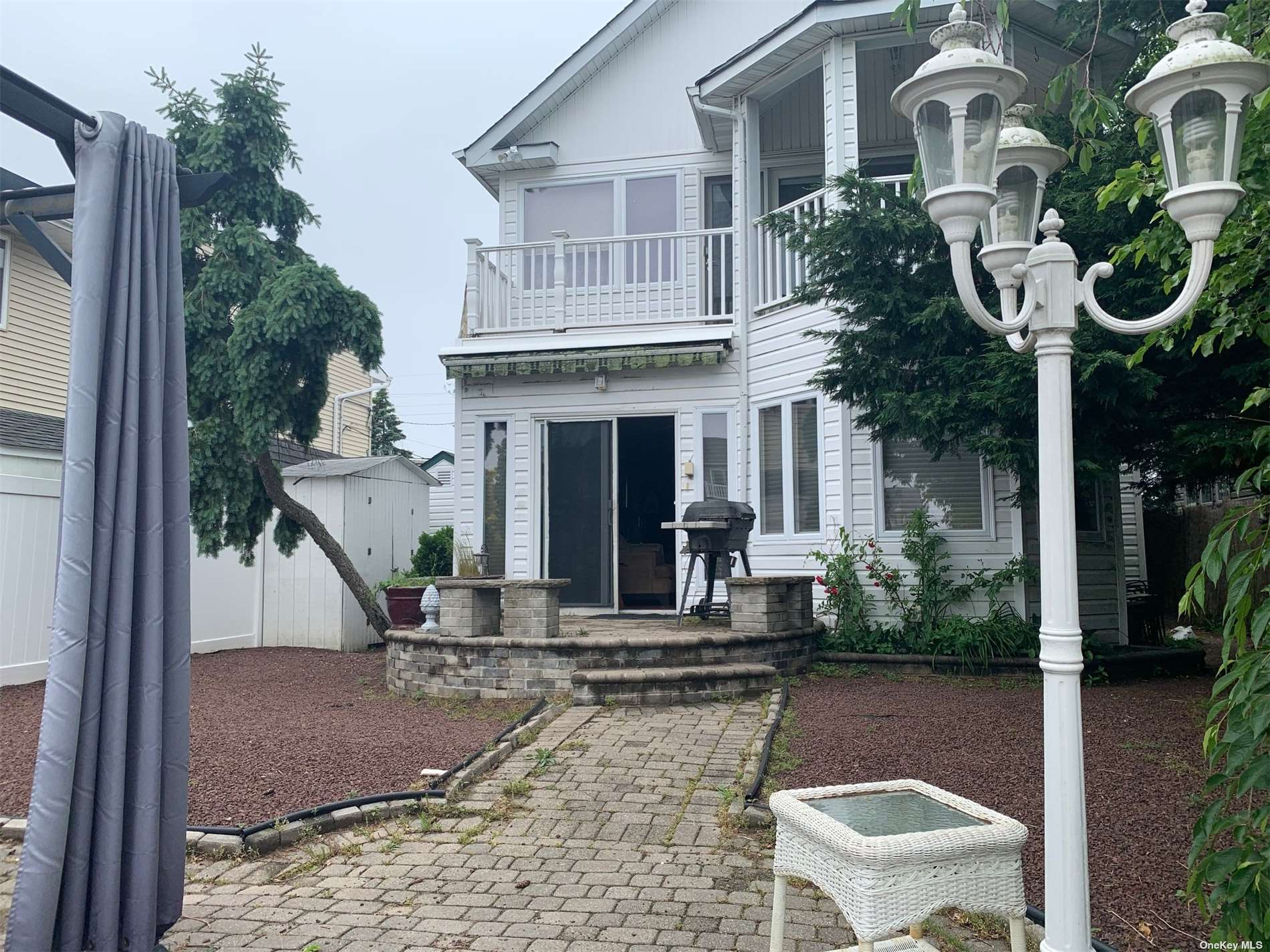 Canal property. Perfect boaters house. Master bedroom with walk-in closet and balcony overlooking canal. New pex plumbing throughout entire home, new water heater. Walk through attic with lots of storage space. Low maintenance yard, 2 sheds, outside access to utility room.