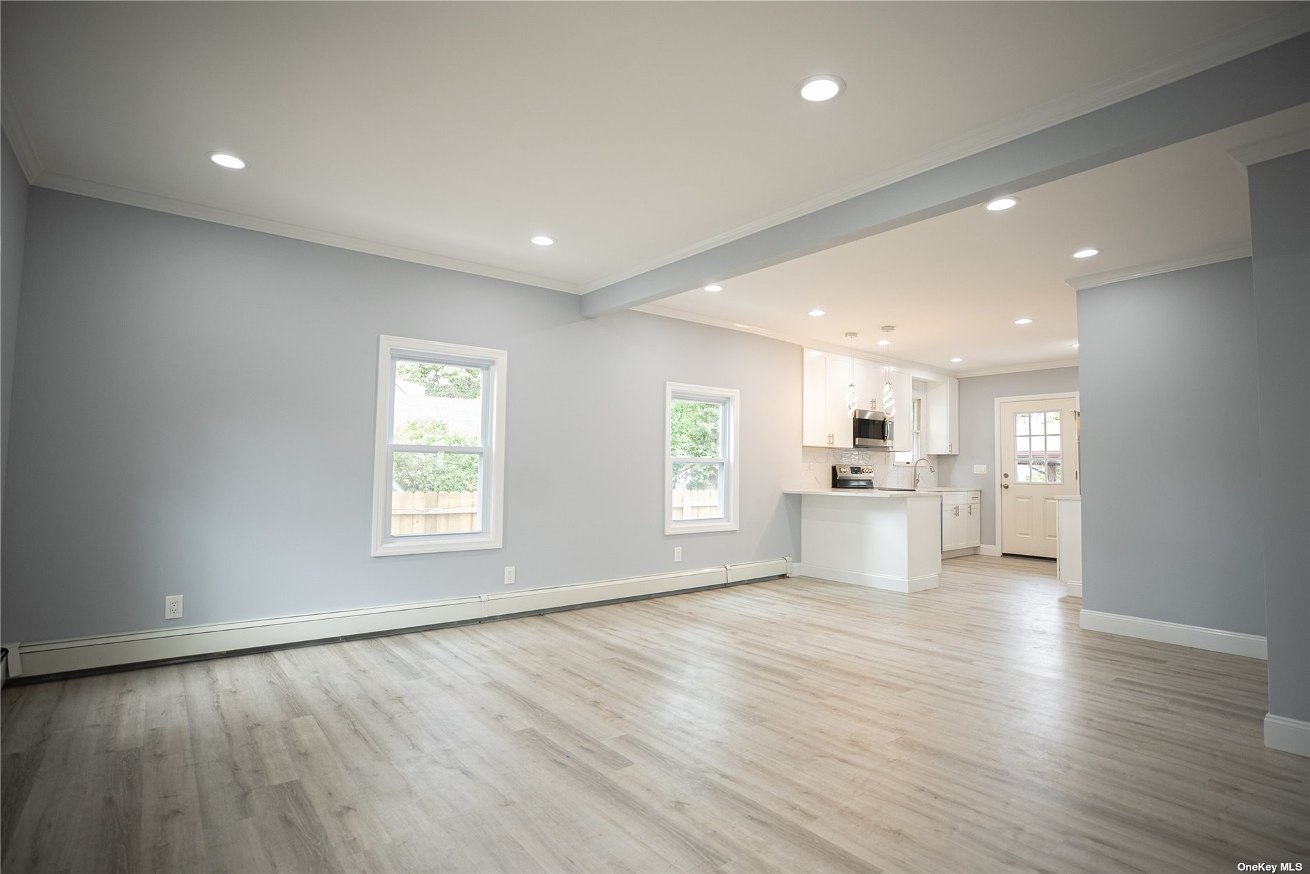 This Amazing Home has Been Completely Renovated. New Kitchen with Stainless Steel Appliances, Open Floor Plan, Large Living Room, 1st. Floor Master Bedroom, Full Bath + Three Bedrooms & Full Bath on 2nd Floor, New Windows, Full Basement, One Car Detached Garage and Much More