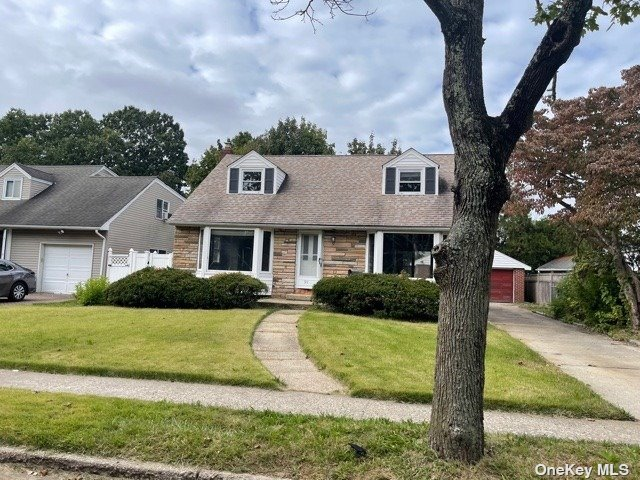 Cape Style Home. This Home Features 4 Bedrooms, 2 Full Baths, Formal Dining Room, Kitchen & 2 Car Garage. Centrally Located To All. Don't Miss This Opportunity!
