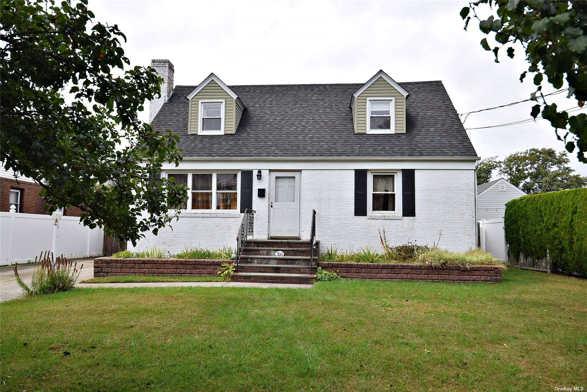 Sun Filled Half Dormered Cape In Massapequa School District. 4 Bedrooms,2 Full Baths, Hardwood Floors Throughout, Western Exposure Backyard, Over Sized Garage, Unfinished Basement, Great Location