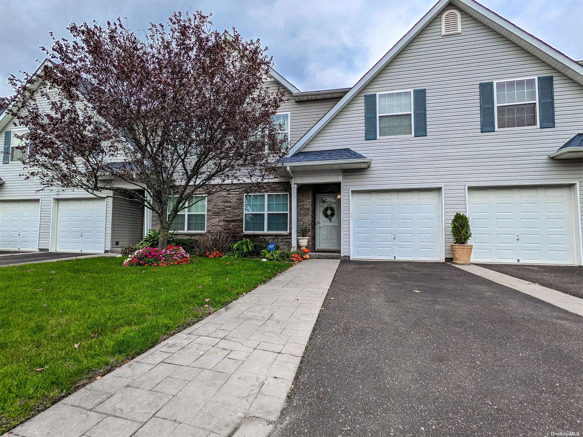 Look no further than this absolute stunner in the Islip Landings Community! Completely custom throughout, this over 2200sqft Townhouse has details upon details. Custom Lighting, moulding, and other touches greet you throughout the entire home. The main floor features an entry foyer, hardwood floors, an office or 4th bedroom, dining room, spacious living room with cathedral ceilings and a gorgeous led chandelier, huge custom kitchen, and entry to the backyard patio and 1-car garage. The second floor features a Master Bedroom with Full Bath en-Suite, 2 additional bedrooms, Full Bath, and Laundry. The full finished basement is a great hangout, with movie theatre setup, 1/2 Bath, and Storage. Amenities include in-ground heated pool, clubhouse, and gym, as well as on site security. This is a must see!!!