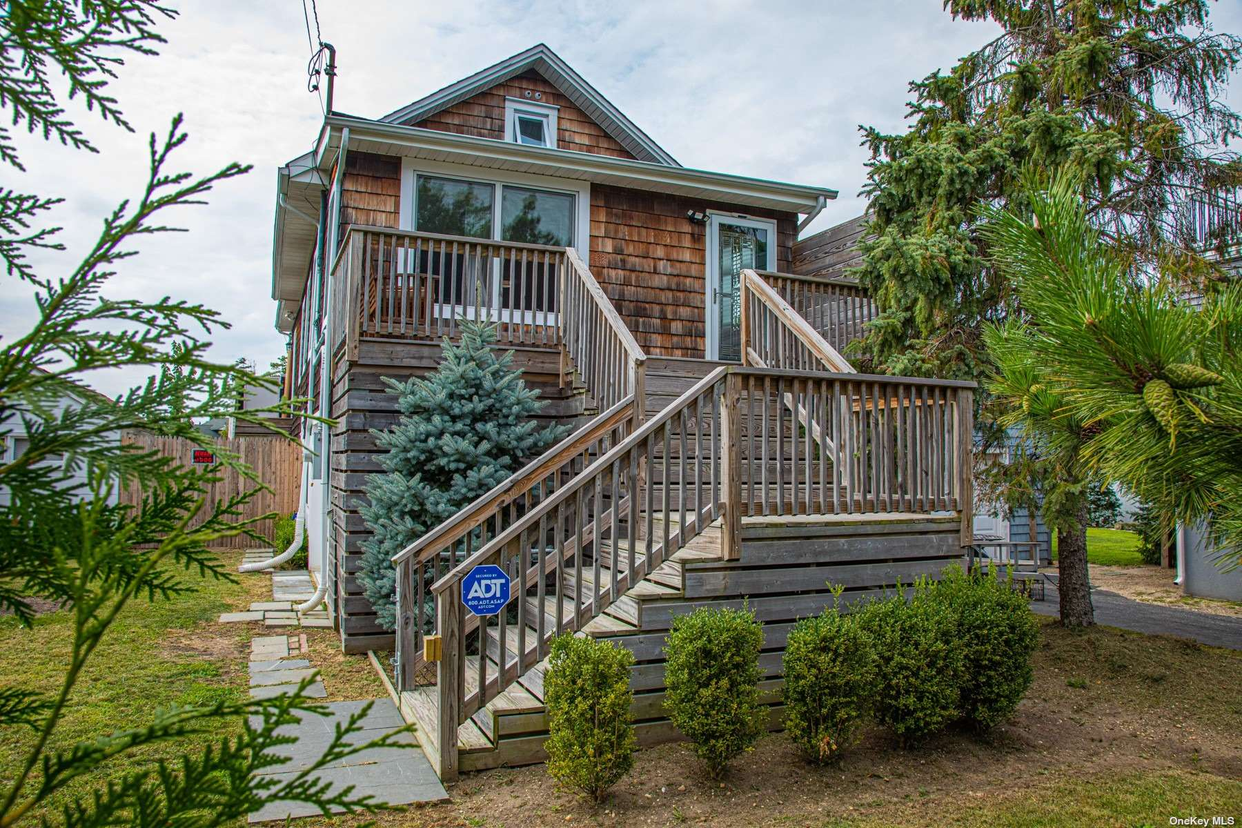 """Everything you dream about in a waterfront getaway! This elevated home offers waterfront views from every room! Originally a two bedroom it was opened for a better flow with the work from home view that overlooks the front porch. Elevated in 2017 this custom home sits on 27 helical piles & feat. a full walk out unfinished basement. Top of the line finishes include solid pecan hardwood floors, 6"""" wood moldings, custom wood blinds and high 9' ceilings! There is an open staircase to the part finished loft with skylights! The kitchen features porcelain tile floors, quartz counters, a viking range and Fisher & Paykel appliances. Designed to embrace the waterfront lifestyle you will not be disapointed with the screened in sunroom, 50 ft of navy bulk heading (2015) with a 50 x 8 deck, boat ramp and 27 x 9 ft out building to store all of your waterfront toys in! There is an Trust-T-Lift in the back for easy access as well as a mud room to complete this dream home!"""