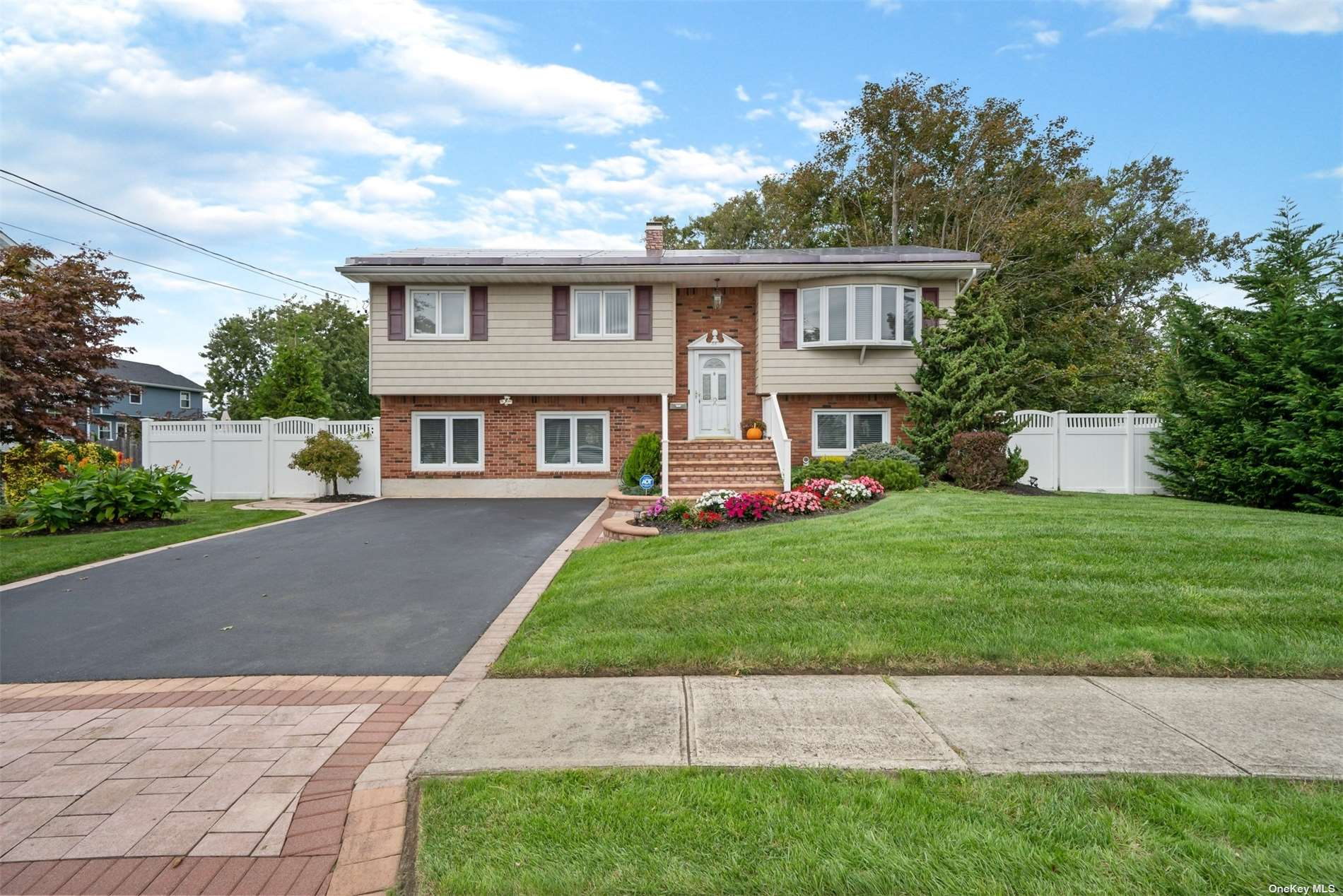 Welcome to this Beautiful Custom Wide-line Hi Ranch, Located in the Stunning American Venice Section of Lindenhurst. This Home Boasts 5 Bedrooms and 2 Full Bath and is Completely Move in Ready. This Home has been Meticulously Maintained. It is a True Gem and a Must See!  It sits on an 80 x 100 Fenced Lot with a Private 2 Car Driveway. The Backyard Features an Elevated Deck, Covered Patio, and an Above Ground Pool. Possible Mother-Daughter with Proper Permit!  Perfect Opportunity for Additional Income or Extended Family!