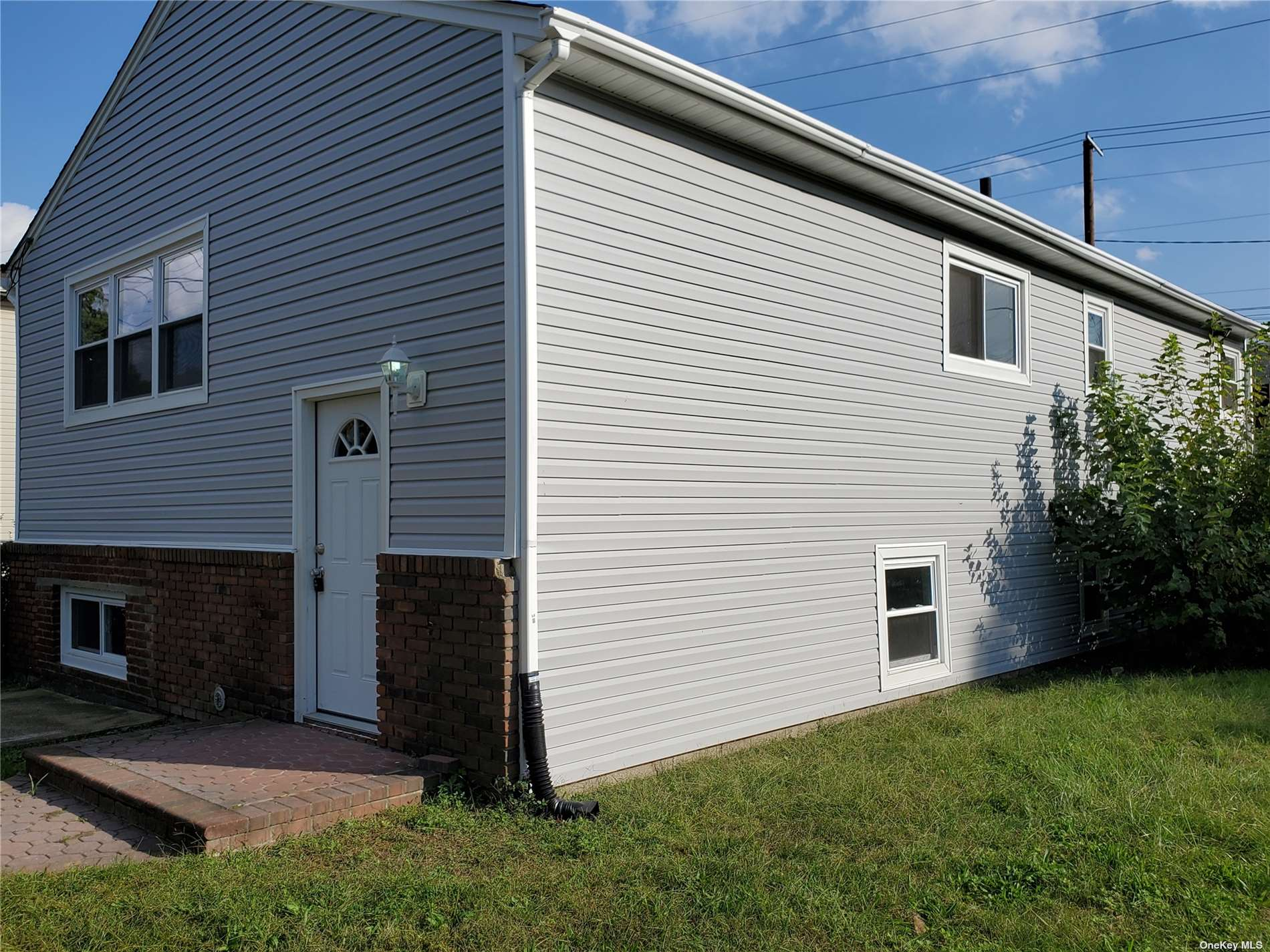 Renovated Hi-Ranch/Raised Ranch with ductwork for central air. Walking to the upper level consist of hardwood floor through out Lr, Dr, 3 bedrooms and Kitchen, Bath. Walking to lower level consist of Lr, Den, 2 bedrooms, and bath with Outside Entrance.