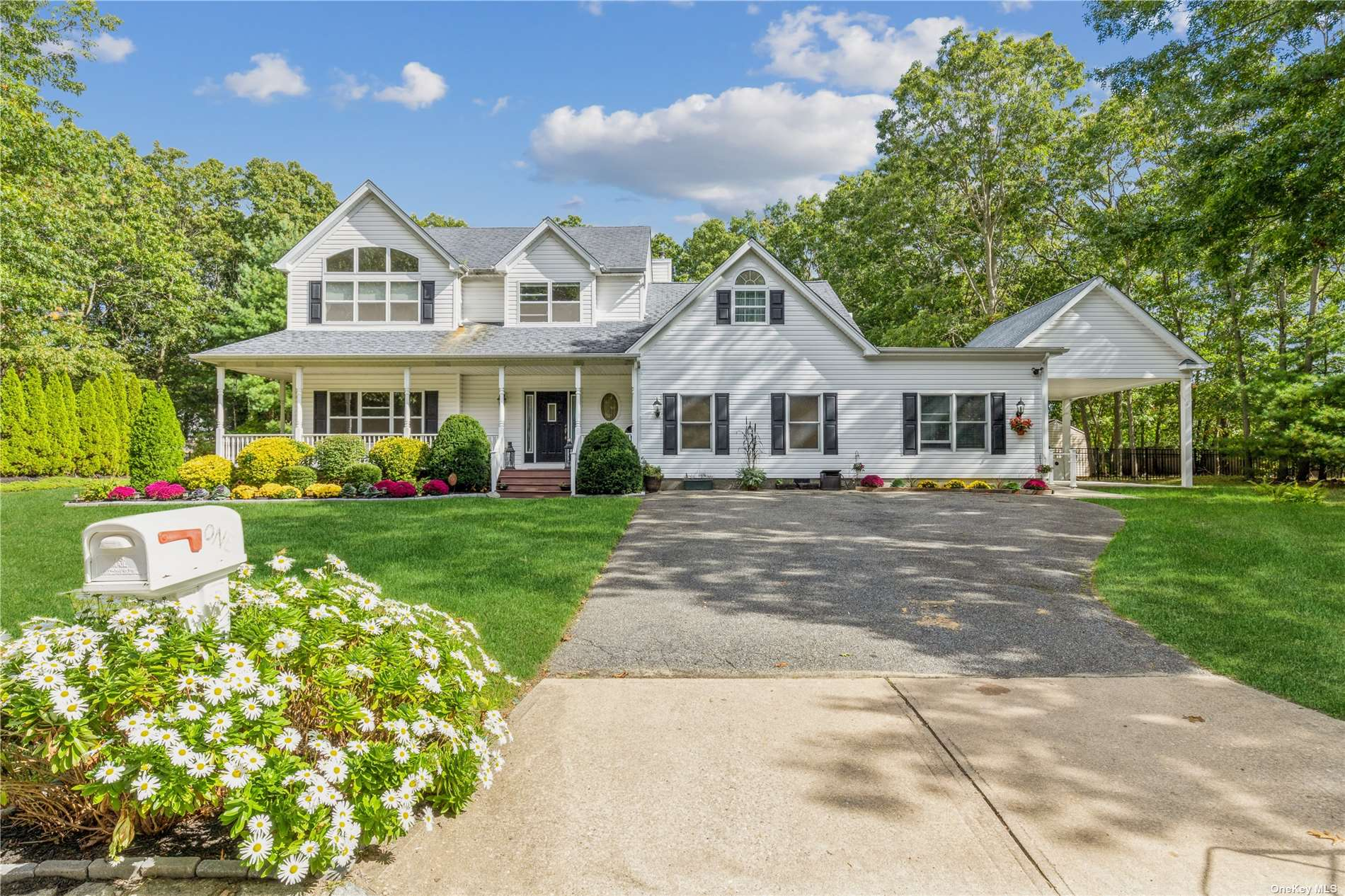 Welcome to this unique and private expanded Colonial in the heart of Old Medford. Walk in from the wrap around porch into a large foyer area that leads into the kitchen, LR and formal DR. Upstairs you will find an open Office area, 2 large bedrooms and a Master BR with an en suite bath. W/D and WIC also can be found on the second floor. Full basement with utilities and plenty of storage. The extension of this 4 bedroom, 4 bath home includes ADA Compliant ramp &  railing,  open floor plan, eye level windows, Barrier free roll in shower with a double drain system, a separate Bliss Spa as well as an additional W/D.  An accessible entry ramp is located under the Covered Carport outside the separate entrance. This beautiful home is situated on a very private corner to corner lot which features a new 16x32 salt water in ground pool surrounded by paver stones. A true Gem!