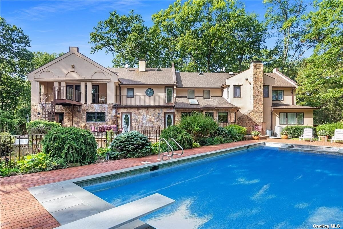 This Magnificent Colonial Sits High On A Grand Front Lawn On Over 2 Acres Of Manicured Tree-Lined Property At The End Of A Private Cul-de-sac. The Home Boasts A Stunning Stone & Masonry Exterior, 5 Car Garage, & Multiple Balconies Overlooking A Secluded & Serene Backyard. The 2-story Foyer Opens To A Formal Living Room & Dining Room Adjacent To A Large Den w/ A Wood Burning Fireplace. Almost 7000 Sq. Ft. Of Living Space, The Home Features An Expanded Gourmet Kitchen, Custom Italian Cabinets, Expansive Island, & Peripheral Views Of The Backyard Oasis. The 1st Floor Includes Separate Guest Living Quarters & Additional Kitchen. The 2nd Level Features 4 Bedrooms & 3 Full Baths. The Primary Suite Epitomizes The Ultimate In Luxury Living w/ Cathedral Ceilings, 4 Walk-In Closets, & French Doors Leading To A Covered Balcony Overlooking A Resort Like Yard. Spiral Stairs Lead To A Two-tiered Patio Featuring A Large Pool & Separate Wading Pool. Laurel Hollow Beach & Mooring Rights Included.