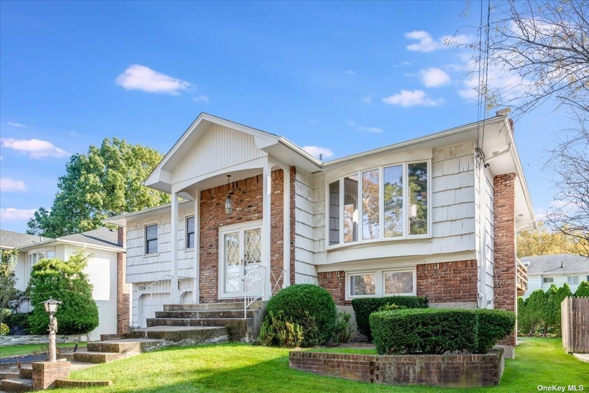 Immaculate high ranch on quiet block in award winning school district #14 Woodmere, with sparkling kitchen and baths, all hardwood floors, ready to move in immediately.  No flood insurance required, no Sandy damage. Taxes listed are without STAR exemption of $1,778.