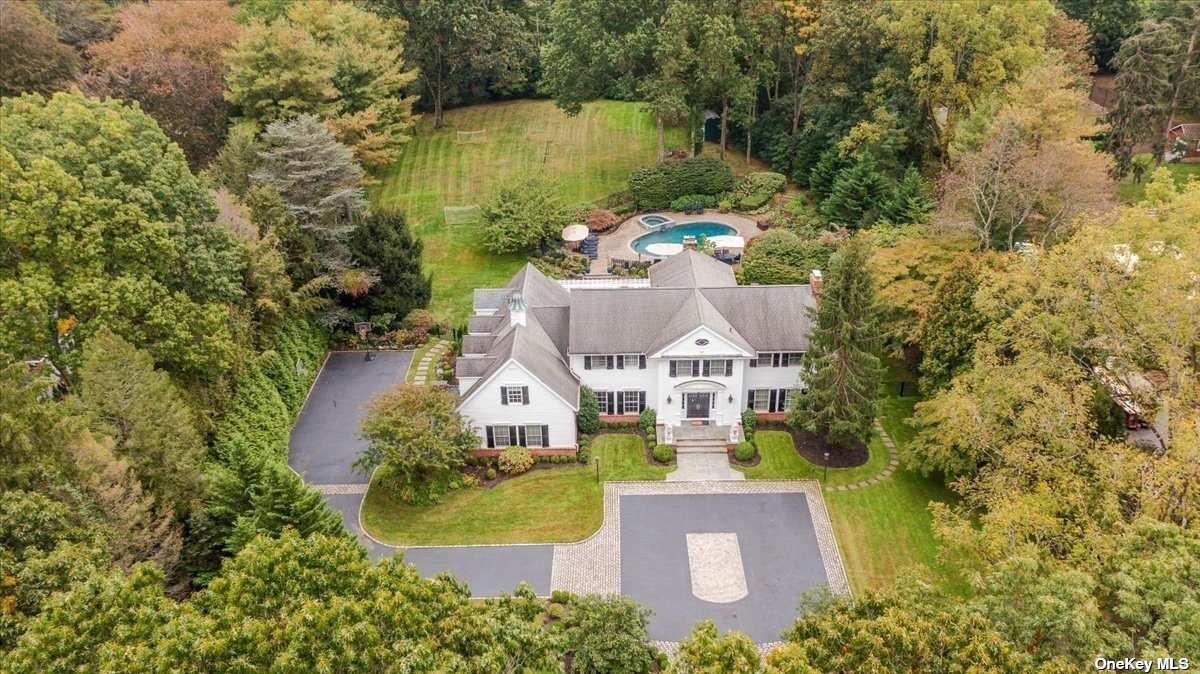 OLD WESTBURY, RENOVATED, Magnificent and Charming Central Hall Colonial; Located On Over 2 Private Acres In The Village of Old Westbury, Featuring 6 Bedrooms, & 5.5 Baths, 3 Car Attached Garage. 2 Fire Places. Chef's Remodeled, Large Kitchen with a Breakfast Area Overlooking to your Private Backyard. Radiant Heat Floor, High Ceilings, Build in Sonos Speakers throughout the house and outside. Central Vacum. Walk-Out Full Finished Basement with all the Amenities. Multiple Exterior Patios, Gunite and Heated In Ground Pool with Separate Shower Outside. Breathtaking Landscaping. Incredible Flow and Much More!