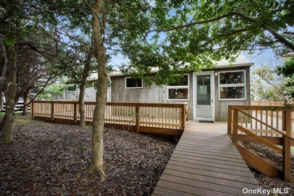 An authentic piece of Pines history. First time offered. 1954 beach cottage with many original details.  Excellent opportunity for expansion. 2 bedrooms, 1.5 baths.  Wood burning stove, outdoor shower.