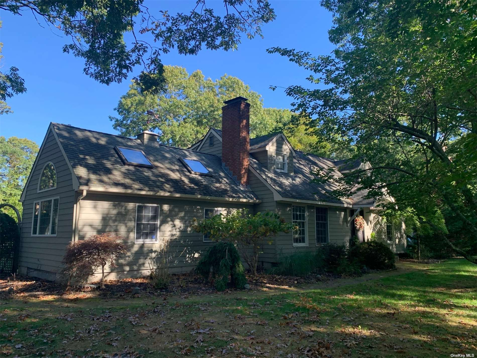 Located in the sought after Bay Estates area of East Quogue. This house backs to a 5 acre wooded preserve. Has a large in-ground pool with new liner and pool equipment. The house has 1st floor master, very large living room, dinning area with fireplace and a very large kitchen.