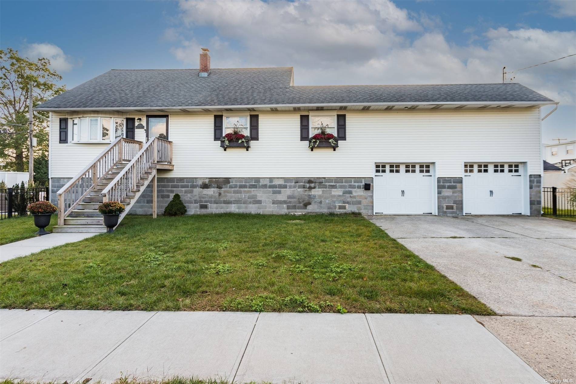 Raised expanded cape with renovated kitchen,stainless steel appliances, 6 burner stove w/griddle & 2 ovens, washer/dryer. 3 bdrm 2 full bath.