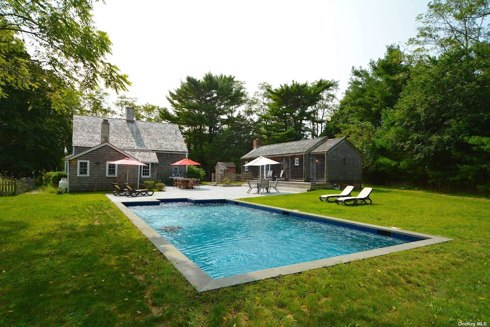 Magnificently restored historic farmhouse with heated, Gunite pool on private, shy 2 acres. Enter through the long country driveway to the pool/guesthouse and large wine cellar that could easily be transformed into a state-of-the-art gym. The main house has been lovingly restored to it's original with modern updates throughout. As with most homes of this era, the home was anchored by three central fireplaces: one for cooking, one for baking and the other for heat. These could easily be converted to gas. The formal dining room is off of the open dining/living area and the beautifully appointed en-suite Master bedroom with a private courtyard is off of the classic den/library. The modernized kitchen still has remnants of the original cooking garden directly outside. Upstairs has an additional two bedrooms and a renovated full bath with walk in closets. The pool-house with fireplace/full bath resides adjacent to the pool & large patio and sits atop an extensive wine cellar.