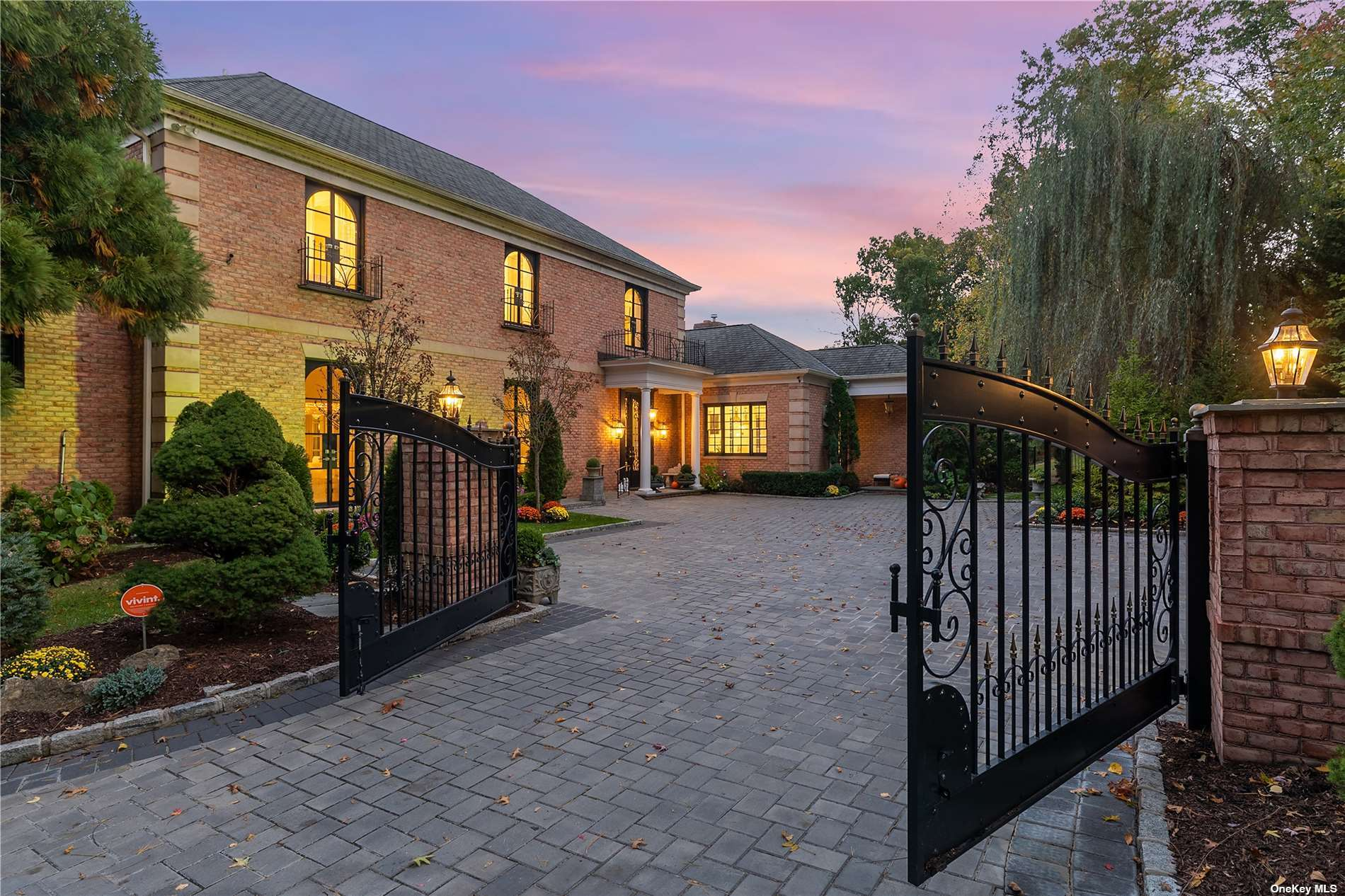 Impressive Gold Coast 21st Century Brick Manor style residence on 3.3 acres with gated courtyard entrance. This 6-bedroom, 6.5-bath designer's own home is exquisitely decorated, appearing in numerous commercial photo shoots. Spacious Public Rooms with high ceilings and ample wall space ideal to display an art collection. A 2-island kitchen with top appliances will be enjoyed by an epicurean cook. Additional highlights include a home theatre, pool/game room, 5-fireplaces, walkout basement with gym. 4-car garage. Picturesque grounds with covered outdoor patio and sparkling pool. A stately Guest House features 2-bedrooms and views of the adjacent Louis C. Clark Sanctuary Preserve owned and managed by the North Shore Land Alliance. No neighbors in the back, ever.  Complete privacy in the Village of Old Brookville. Just 25 miles to NYC, offering numerous golf/tennis clubs, marinas, biking trails plus cultural venues and numerous restaurants and shopping options. North Shore School District.