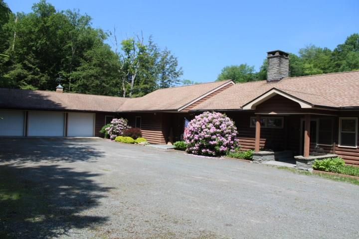 ACCEPED OFFER..7/1/2020..back ups being accepted  .....owner is highly motivated... Sitting next to the famed Beaverkill River in Lew Beach NY at the gateway to the Beaverkill Valley is this immaculate 5000SqFt custom ranch with stunning river views on .5 acres with two 5 acre parcels directly across the road (3-1-8.4,8.5) included in the sale to maintain your privacy. House was completely renovated and expanded in 2006 and has lots of features that include central AC, hardwood floors, 2 sided fireplace, covered deck overlooking the river where you can watch bald eagles and deer, large custom kitchen, ground floor master suite with walk in tile shower and closet, library/office, great room with scenic views of the Beaverkill River, vault room for storage of your valuables, lower level storage rooms for hunting and fishing equipment, generator to ensure emergency power, wired for high speed internet and cable television, less than 2 hours to NYC and a short ride to the Town of Livingston Manor, minutes from public access trout fishing,