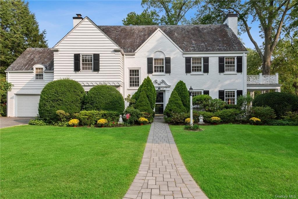 Natural beauty abounds in this gracious and welcoming Fox Meadow colonial in the heart of Crane Berkley. Set on lush park-like grounds this Collet built home offers the perfect location just a short stroll to Scarsdale village and train. Its classic design blends the traditional with an open flow to a tranquil formal living room w/FPL and adjoining sun porch, a spacious dining room with built-ins, new PR, and elongated family room with custom library and magnificent water views from floor to ceiling windows. The bright kitchen features ss appliances, recessed lighting & tiled floor w/adjoining butler's pantry. The second floor boasts a master suite w/new bath with radiant heated floors, three bedrooms on this level share an updated hall bath, and two additional bedrooms are accessed via a second staircase sharing a hall bath. A finished playroom on the LL is fun for media, exercise & games w/wine storage and laundry. The perfect Scarsdale home!
