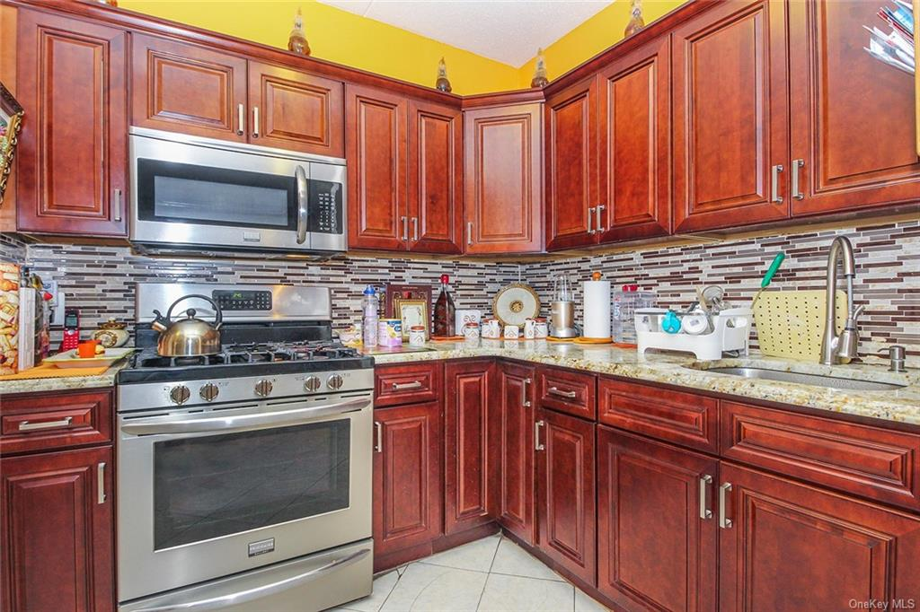 START PACKING! A real two bedrooms Condominium in the Melrose section of the Bronx! The unit has so much to offer. This 3rd-floor unit comes with plenty of cabinets kitchen, open floor plan with the living room/ dining room. Washer and Dryer Hook-Ups.  It features King and Queen size Two bedrooms with beautiful tile floors and closets.  Gated community Conveniently Located Near Major Highways, Public Transportation, Schools, Playgrounds, Places of Worship, 2 blocks walk to the 2 & 5 train which will have you in Manhattan in 30 minutes or less. Just start packing and move right in.