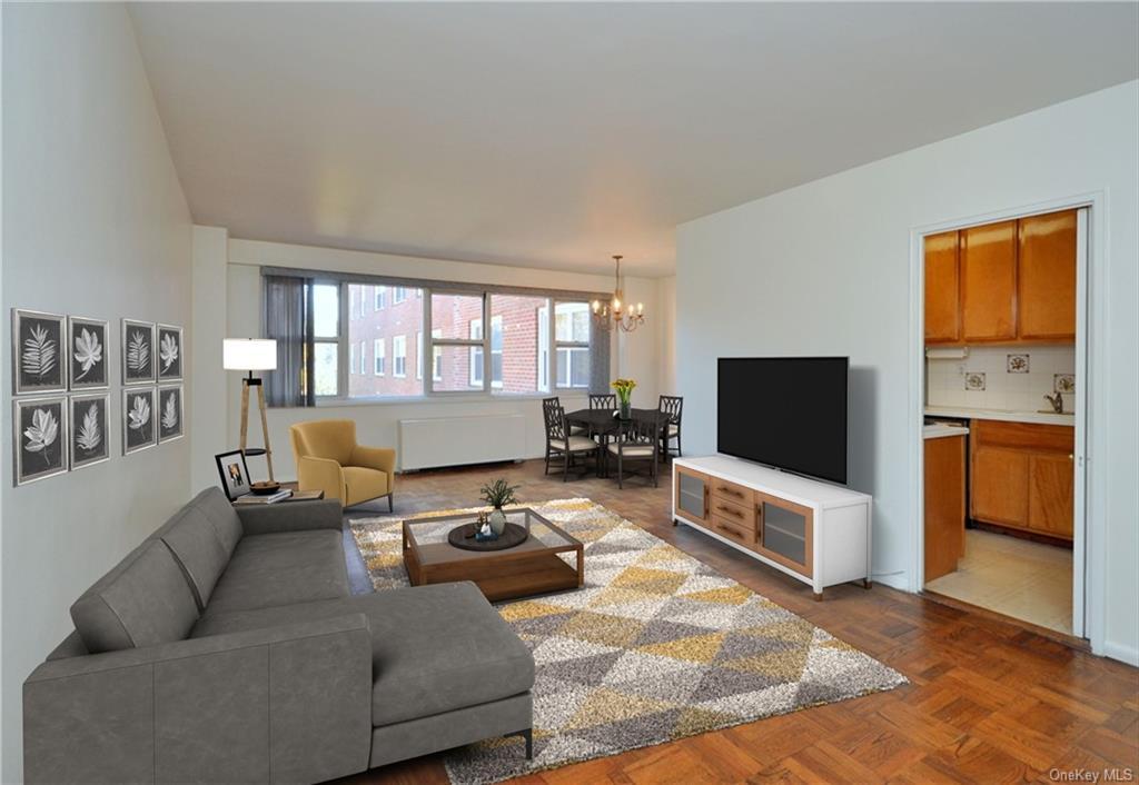 Bright living room has tree top views, parquet floors,