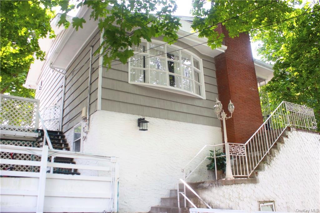Easy to show this great 2 story colonial in NW Yonkers, located on a secluded, quiet road off of N. Broadway. Great location-close to schools, shopping, & bus. Lots of parks nearby. 1st Floor includes: LR w/2 sitting areas & FP & HW floors, Formal DR, & K w/granite countertops & SS appliances & Pantry, Powder Room, & Laundry Room. Upstairs includes: 3BR's & 1 full bathroom w/bathtub. Basement is walk-out & is mostly unfinished but includes a Bonus/Office Room & a Bathroom w/shower. Landscaping needs work. Backyard is sloping. Aluminum siding.