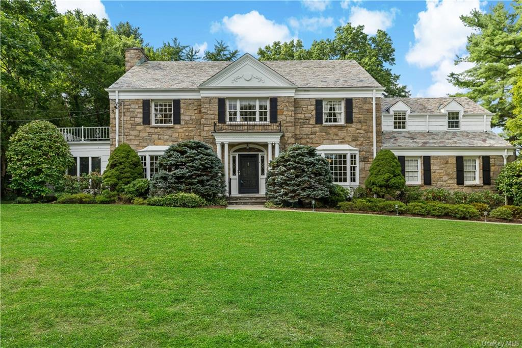Picturesque Colonial with serene pool located on one of Scarsdale's premiere Quaker Ridge streets. Set back on park-like property behind a private stone wall, this sophisticated and stylish home features five-bedrooms, three-and-a-half bathrooms, nine foot ceilings on the main floor, a gracious flow, generous rooms, home office spaces, generator, and expansion possibilities! The backyard is a true oasis with lush sweeping lawns, a 100+ year old Chinese Ginkgo tree, perennial gardens and an elegant pool designed by Benedek and Ticehurst.  Entertain family and friends or just enjoy the privacy of this classic beauty!