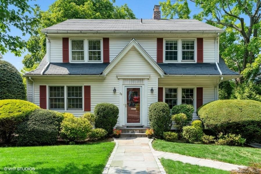 Sunny and bright Center Hall Colonial on a quiet and tree covered street in the sought after Greenacres neighborhood of Scarsdale. Walk to elementary school, the train, shops and restaurants. There are many updates including new bluestone walkway, new sprinkler system for the lawn, new hardwood floors at first level, new crown moldings, new Anderson windows on 1st floor, fully updated kitchen with granite counter top, all updated bathrooms, and new hot water heater. The first level features a long entry foyer, adjacent updated powder room, home office with walls of built-in shelves and cabinets, beautiful living room with wood burning fireplace, expansive family room with sliding door to deck overlooking a nice backyard, modern white kitchen with plenty of cabinets and eat-in space (currently workstation), and gracious formal dining room. The second level includes master bedroom with new master bath with shower, deep tub, and double vanity, 3 additional bedrooms, and a large updated hall bath. The third level features a bedroom, full bath, and storage rooms. The lower level offers laundry and a few more storage rooms. Great flows throughout, move right in!