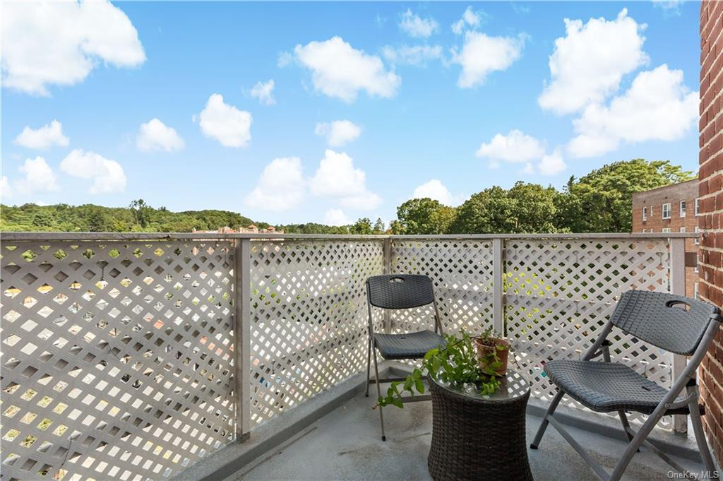 Top floor balcony.  Enjoy your own little oasis in downtown Hartsdale.