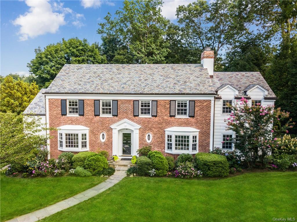 Stately Brick Colonial sits on lush, very private half acre in Scarsdale's coveted Crane Berkley and offers easy stroll on park-like roads to Scarsdale Village/schools/parks. In this prominent neighborhood all utilities are underground, with a parkland/pond, with swans and egrets often spotted, all privately owned by the residents of Crane Berkley. Desirable first floor layout has two family rooms, one newly added ('12), separate home office, library with coffered ceiling, first floor bedroom with private bath, modern eat-in kitchen, powder room and gracious oversized living and dining rooms. Upstairs, the main bedroom is a sanctuary with cathedral ceiling, gas fireplace, two walk-in closets, LUX bath and home office, en-suite bedroom, plus three bedrooms and two hall baths (all bathrooms updated) complete this spacious upper level. The lower level includes a media room plus recreation space with access to the large bluestone patio, with built-in woodburning barbeque and lovely landscaped and fenced backyard. This is the sweet spot of Scarsdale! ROOM FOR POOL!